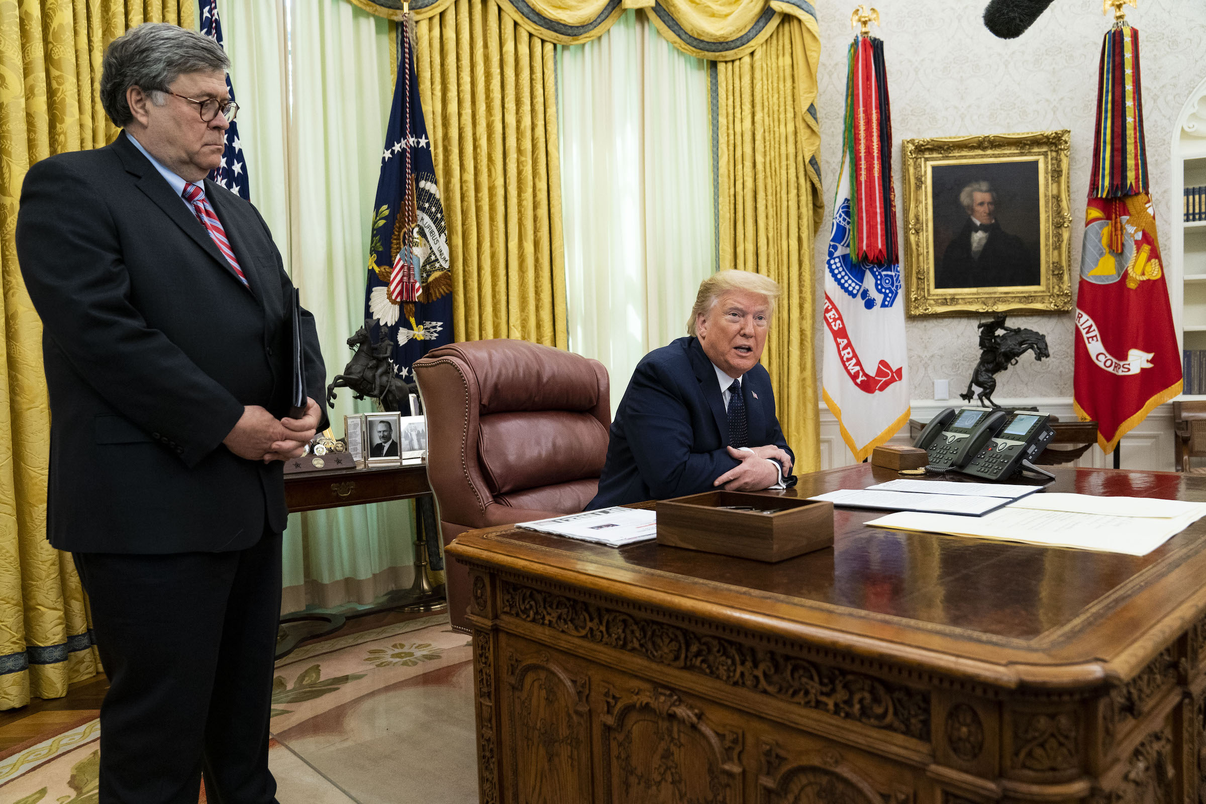 President Donald Trump, right, speaks while Attorney General William Barr stands during an executive order signing event in Washington, D.C. on May 28, 2020.