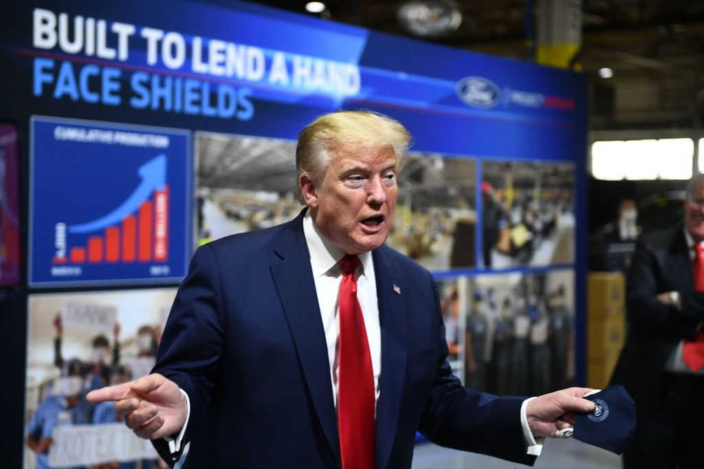President Donald Trump holds a mask as he speaks during a tour of the Ford Rawsonville Plant in Ypsilanti, Michigan on May 21, 2020.