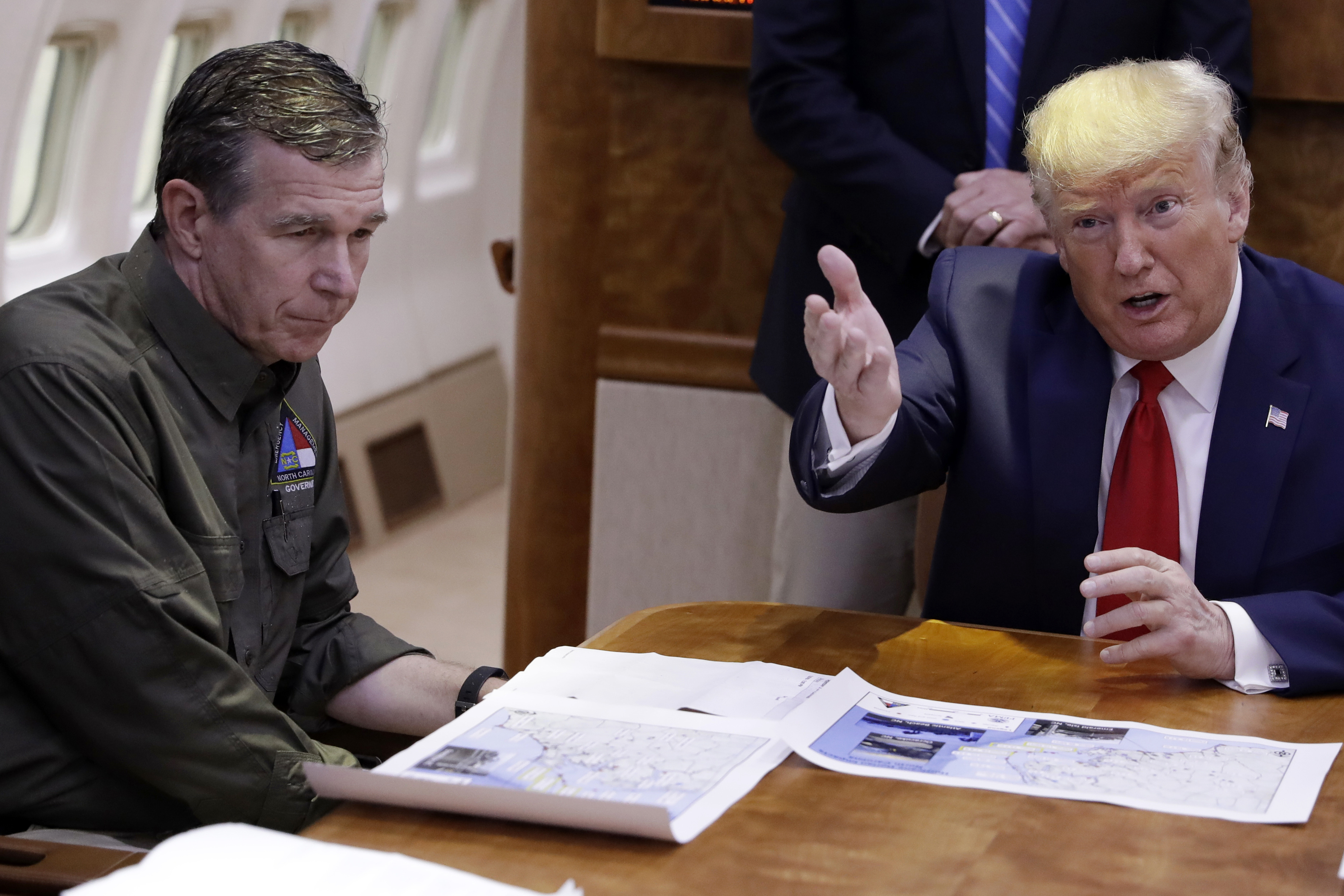 President Donald Trump participates in a briefing about Hurricane Dorian with North Carolina Gov. Roy Cooper, left, aboard Air Force One at Marine Corps Air Station Cherry Point in Havelock, N.C on Sept. 9, 2019.