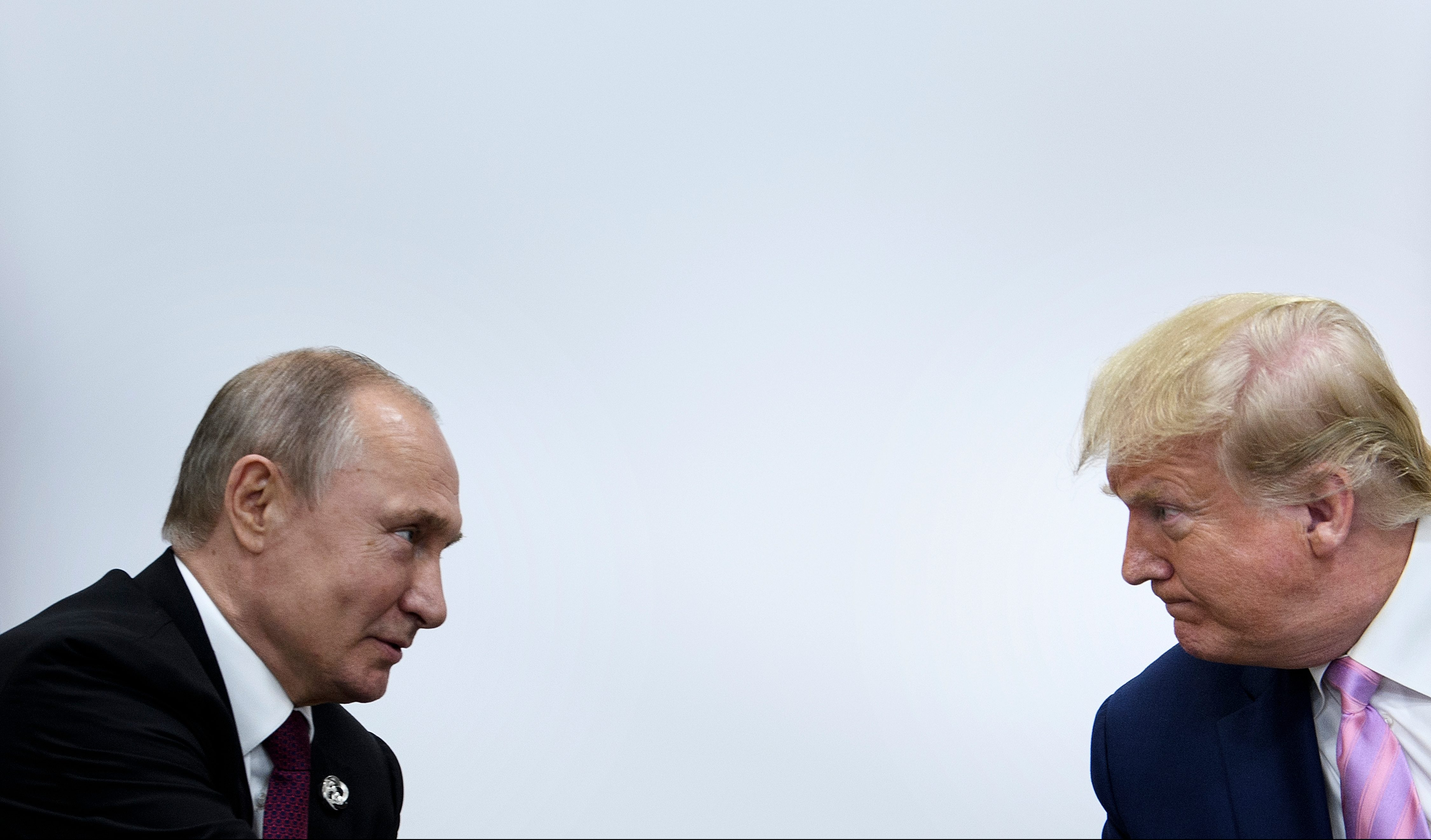 President Donald Trump attends a meeting with Russia's President Vladimir Putin during the G20 summit in Osaka on June 28, 2019.
