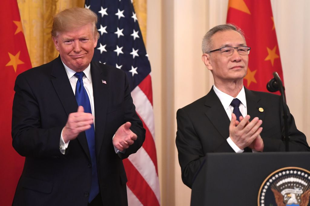 President Donald Trump and Chinese Vice Premier Liu He applaud before signing a trade agreement between the U.S. and China in the White House on Jan.15, 2020.