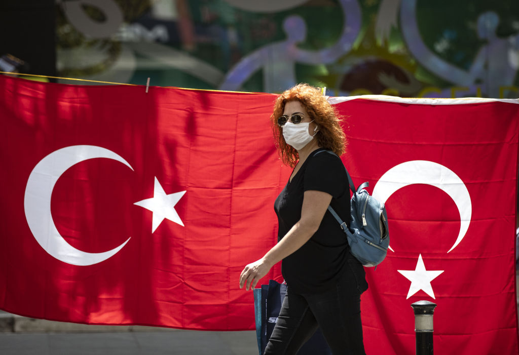 A woman walks on Bagdat Avenue after youths between 15-20 years across Turkey allowed to leave their homes, remaining within walking distance and wearing masks, on May 15 in Istanbul, Turkey.