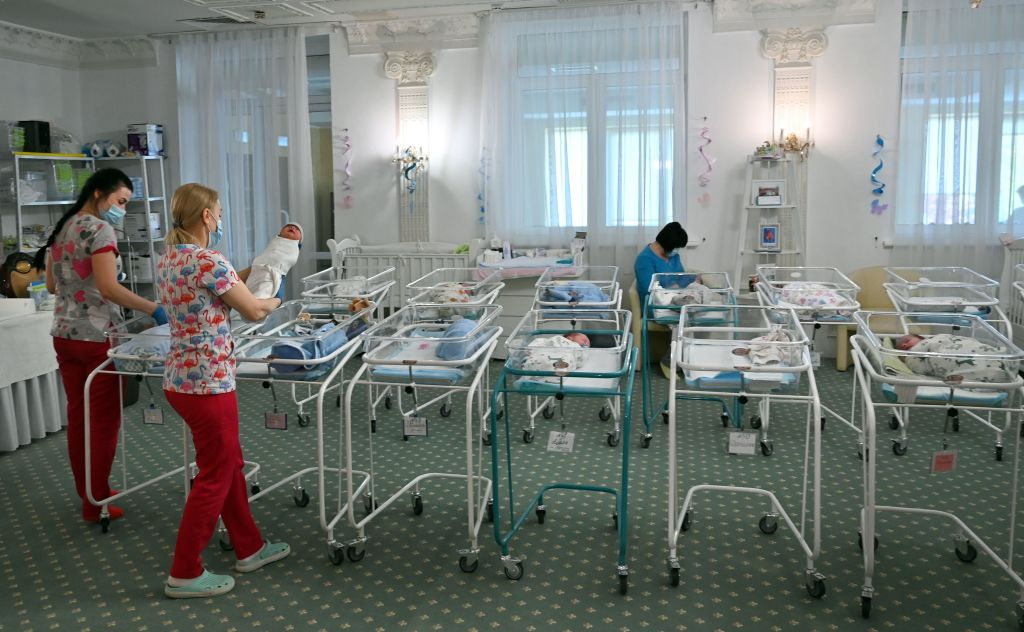 Nurses care for newborn babies at Kyiv's Venice hotel on May 15, 2020