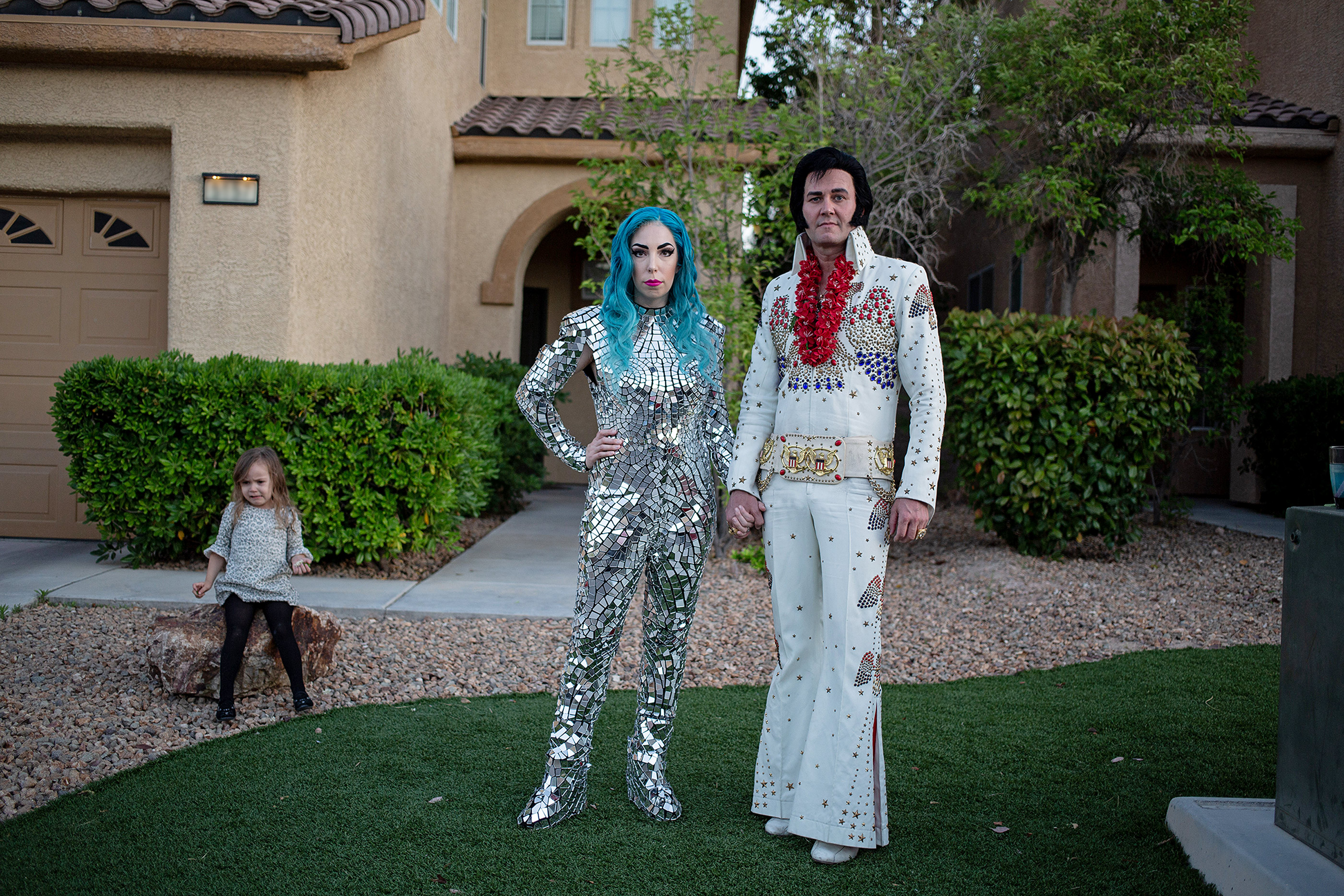 Tierney Allen, 33, Lady Gaga Impersonator, Travis Allen, 42, Elvis Impersonator, and their daughter Charlotte, 3, Las Vegas. The couple is two of more than 80,000 gig workers in Las Vegas who are now unable to make a living.