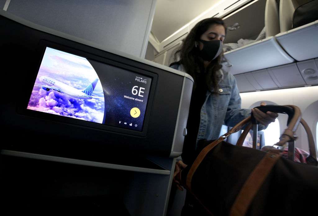 A passenger boards a United Airlines flight to Houston, Texas at San Francisco International Airport on May 11, 2020 in San Francisco.