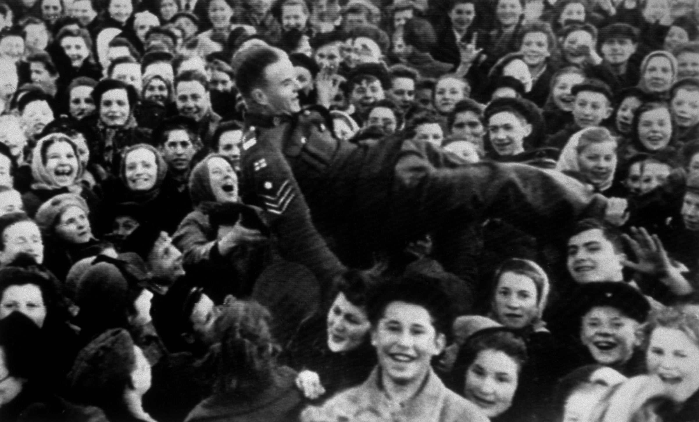 A British sergeant is lifted up as Moscow women celebrate VE Day on May 8, 1945.