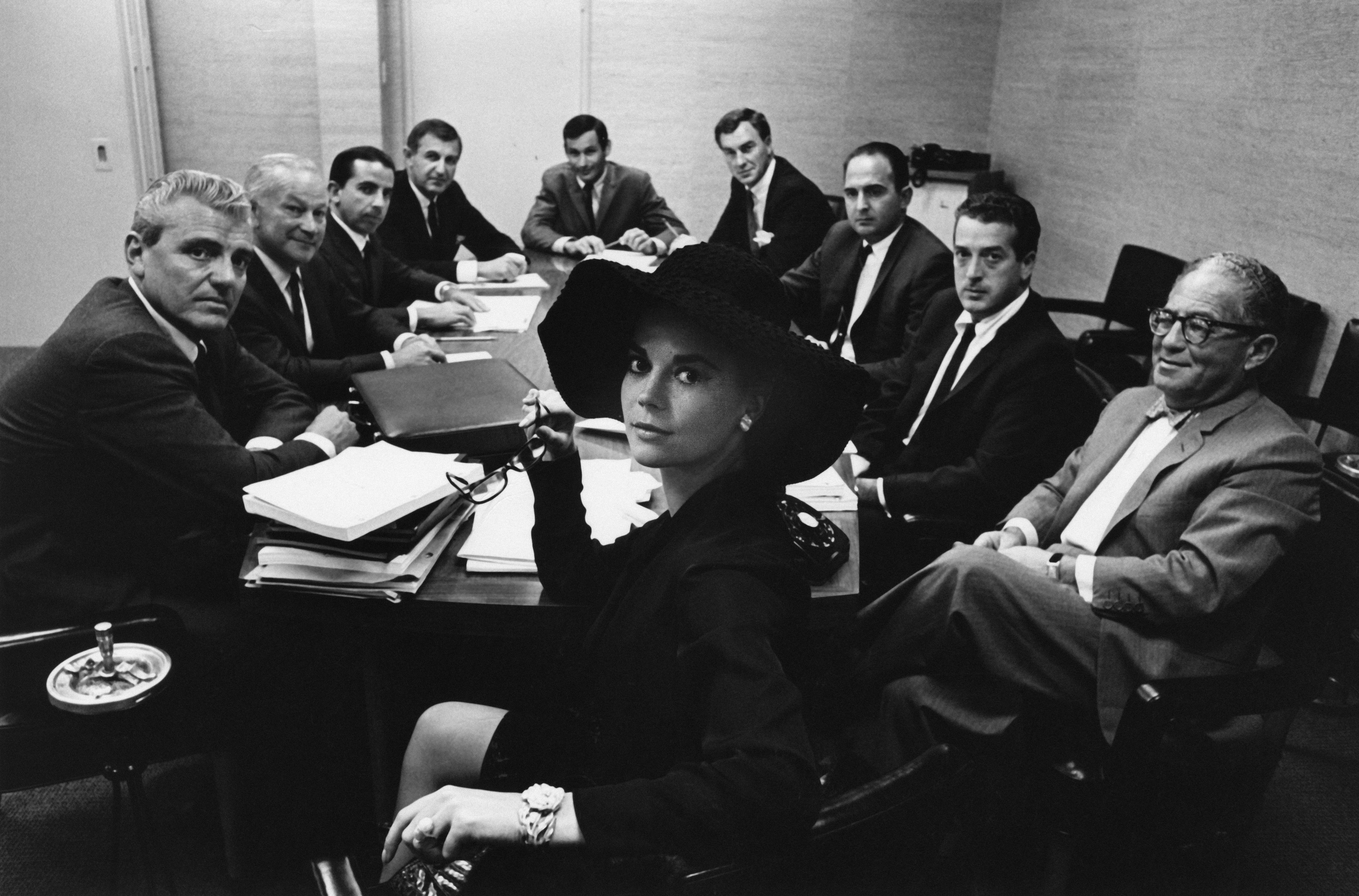 Natalie Wood (center) in a business meeting
