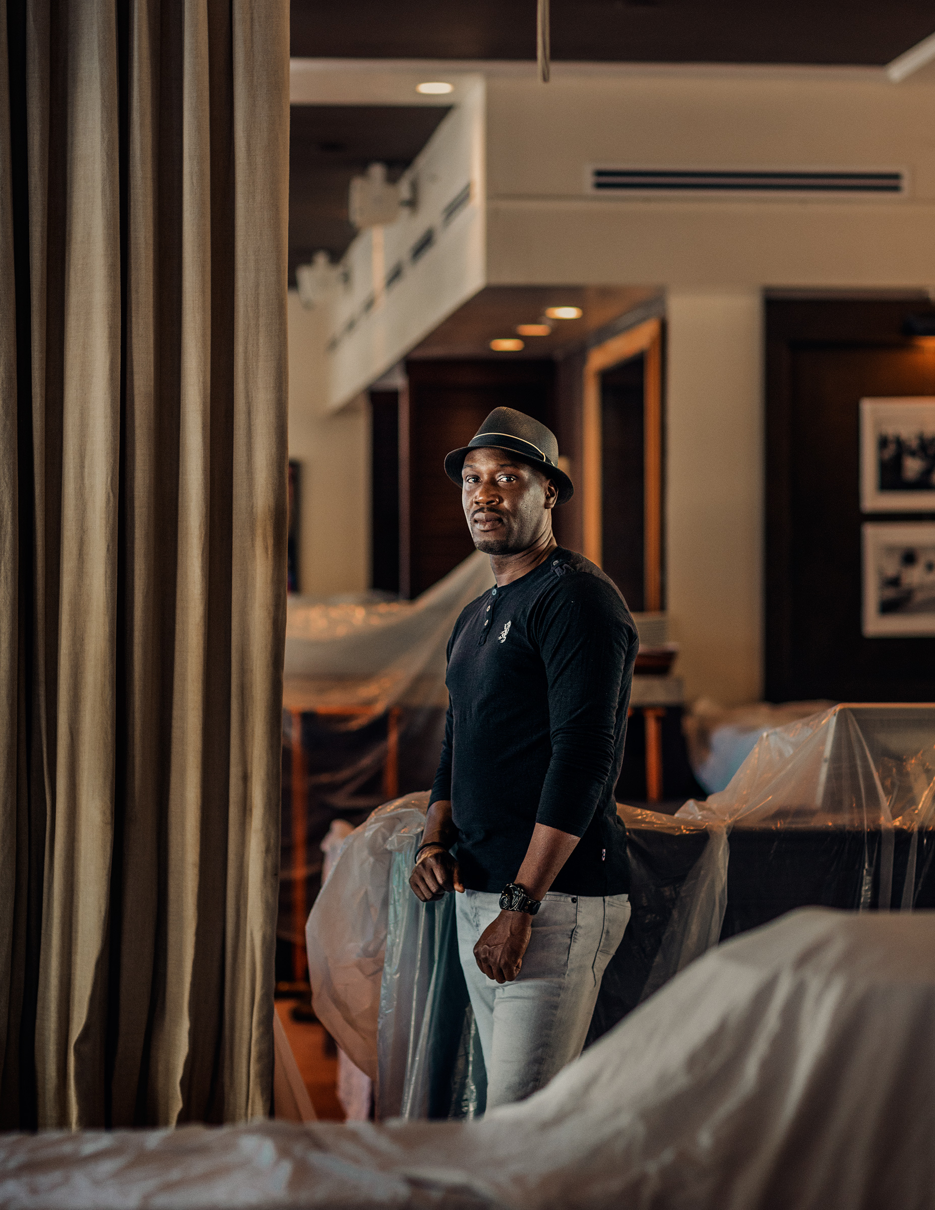 "Fritz Francois, 41, Bell Captain, Miami. With no sign of his unemployment or stimulus checks, Francois, who worked at the Betsy Hotel, has been looking into delivery jobs. For now, though, he's home, trying to teach his 4-year-old son letters and numbers while his wife works as a patient-care associate at a hospital. ""Every day when I wake up, I ask God to shield her,"" he says."