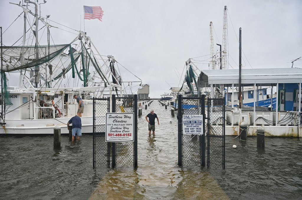 Owners tie down and secure their boats in the Pass Christian Harbor in Pass Christian, Miss., on June 7, 2020.