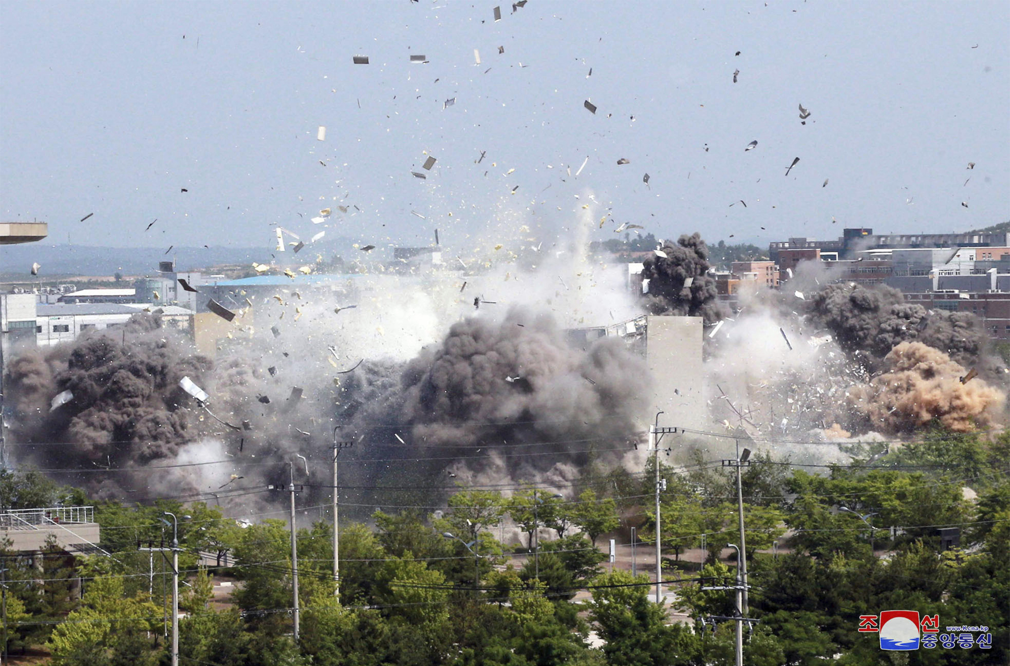 This photo provided by the North Korean government shows the explosion of an inter-Korean liaison office building in Kaesong, North Korea, Tuesday, June 16, 2020.