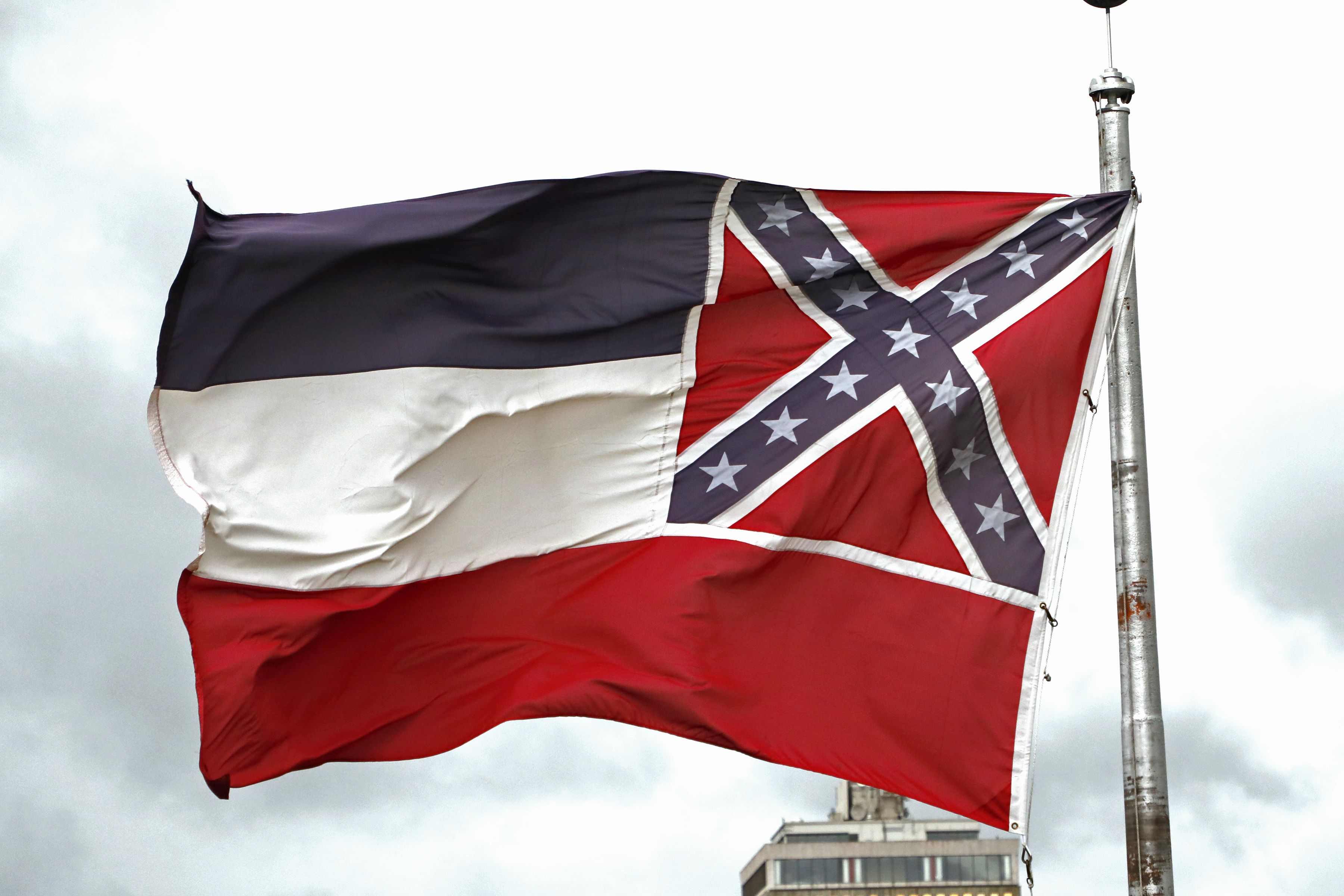A Mississippi state flag flying outside the Capitol in Jackson, Miss., on June 25, 2020.