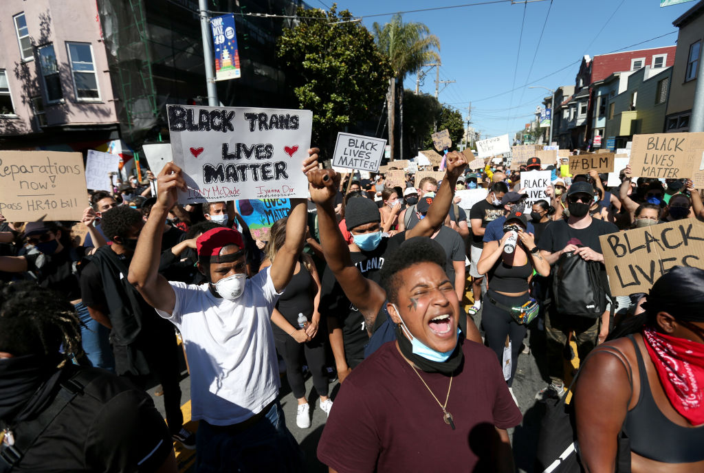 Protesters hold signs and chant during a demonstration to honor of George Floyd on June 3 in San Francisco, California. Thousands of of people came out to honor George Floyd who died after being held down by Derek Chauvin, a former member of the Minneapolis Police Department who has since been fired and charged with third degree murder.