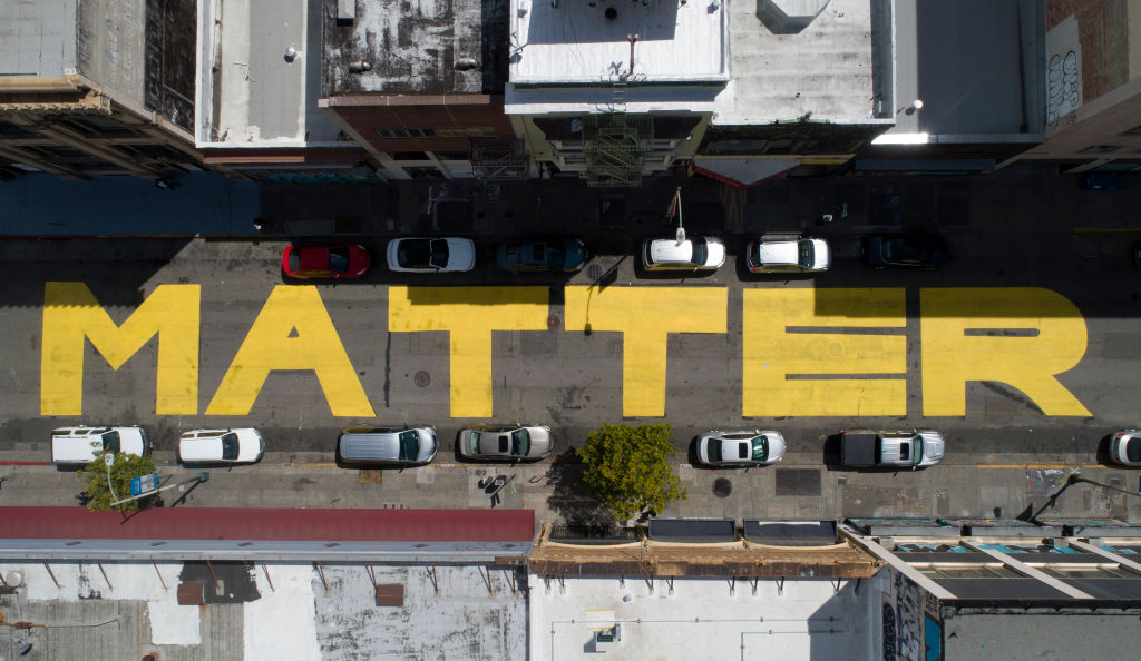 Giant letters spelling  Black Lives Matter  are seen from this drone view on 15th Street in downtown, Oakland, Calif., on Wednesday, June 10, 2020. Similar letters have been painted in Berkeley and Washington, D. C
