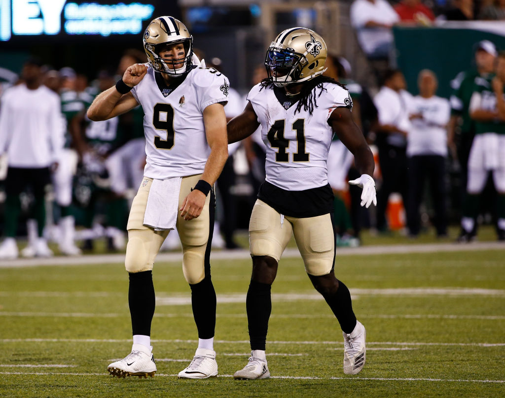 Drew Brees #9 and Alvin Kamara #41 of the New Orleans Saints celebrate a touchdown against the New York Jets during a pre-season game at MetLife Stadium on August 24, 2019 in East Rutherford, New Jersey.