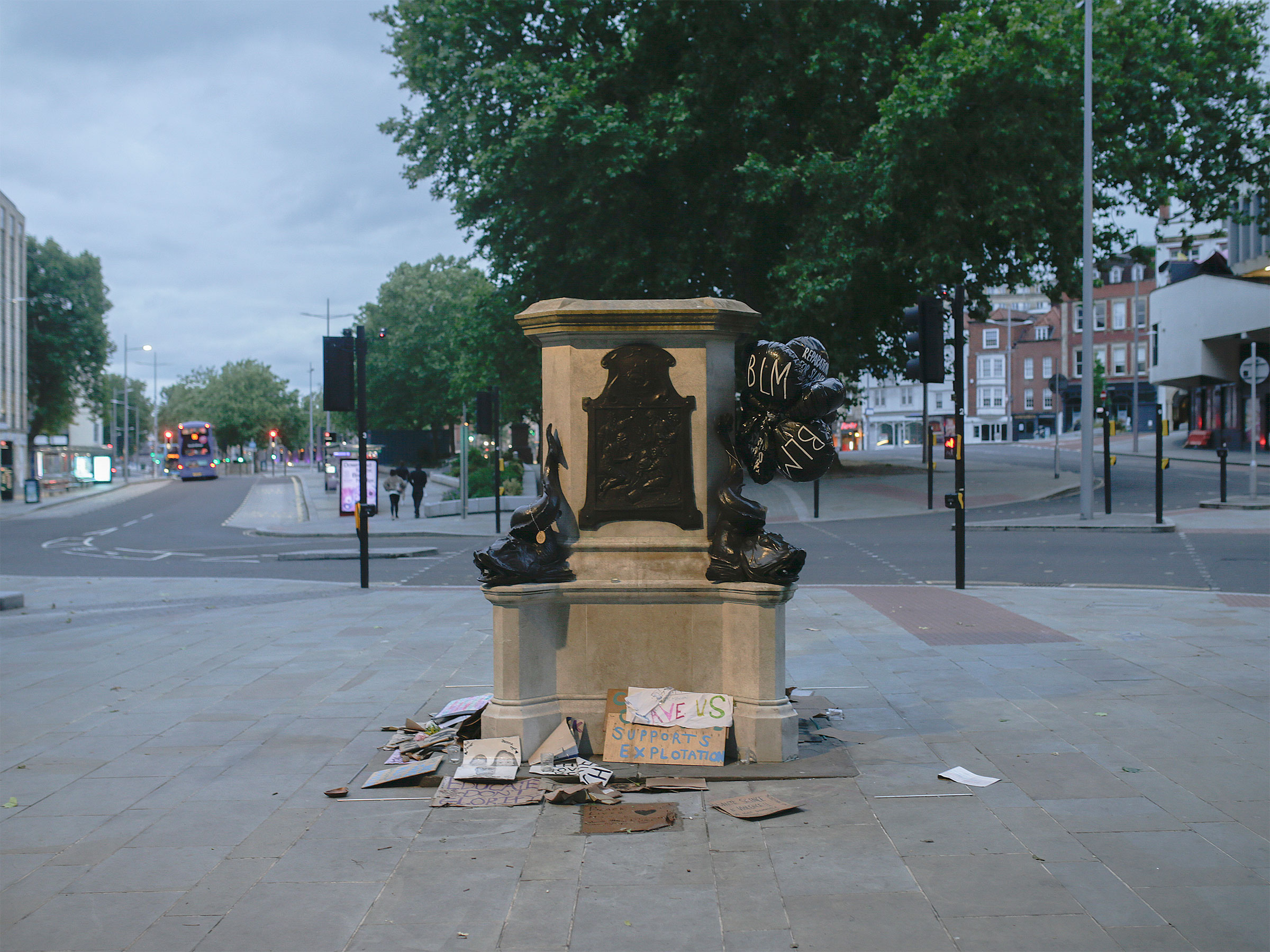 The plinth of the statue of Edward Colston in Bristol, England, is now surrounded by messages of support for the Black Lives Matter movement, June 11, 2020.