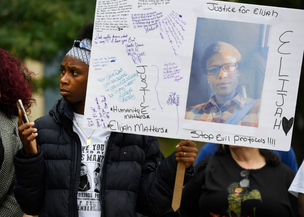 Rashiaa Veal holds a sign of her cousin, Elijah McClain, at a press conference in front of the Aurora Municipal Center October 01, 2019.