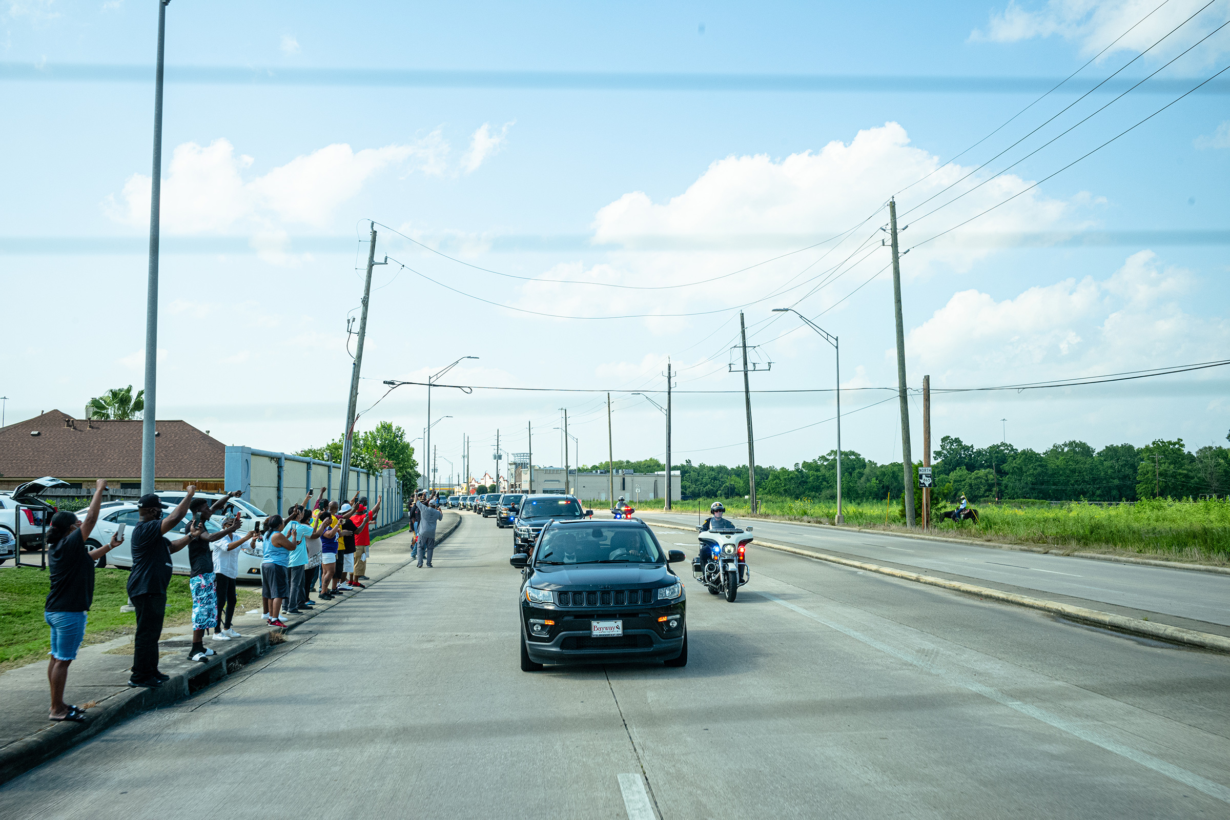 Supporters line up to see George Floyd's funeral procession on Jun 9.