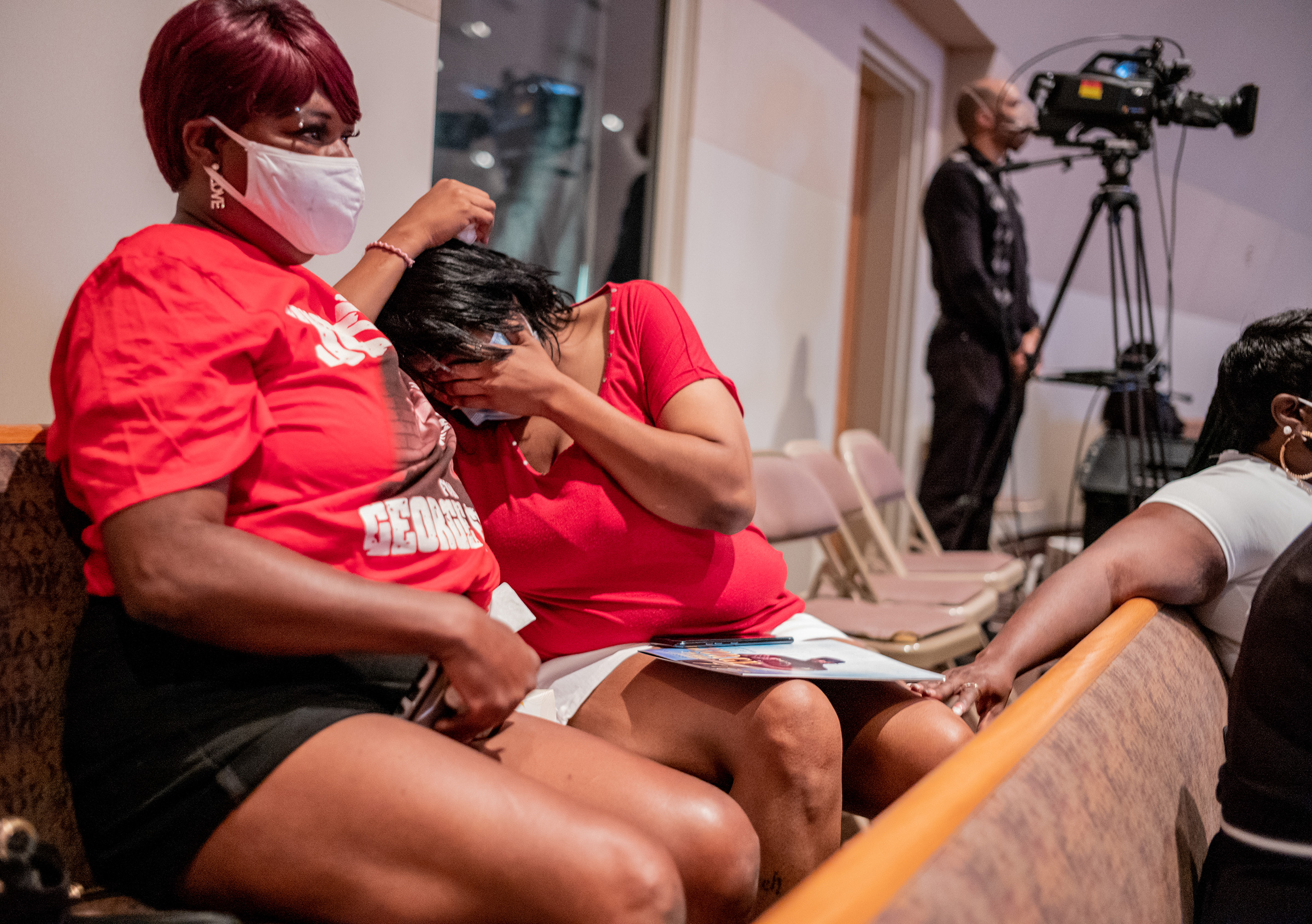 Amalie Mason at emotional moment during the tribute to George Floyd. Family and guests attended the funeral service at The Fountain of Praise Church in Houston on June 9.