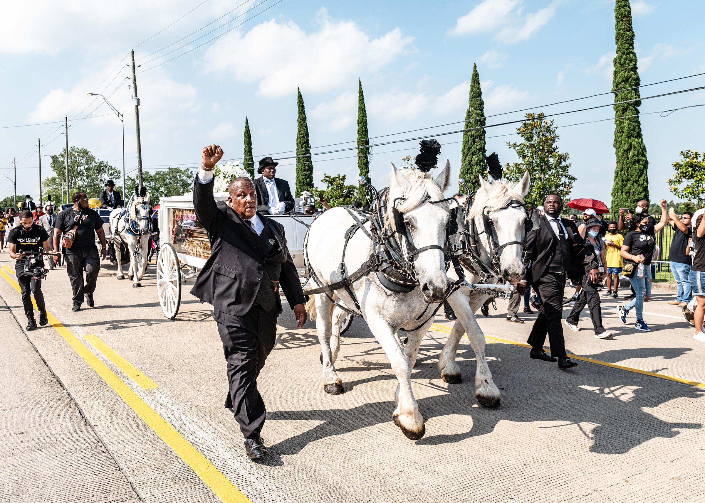 "A horse-drawn carriage brought Floyd's body into the cemetery on June 9. ""It felt like a state funeral,"" Roye said. ""It felt like they were sending him off with the newfound persona that he had been catapulted into, and this was one of the ways to honor what he became. It felt right."""