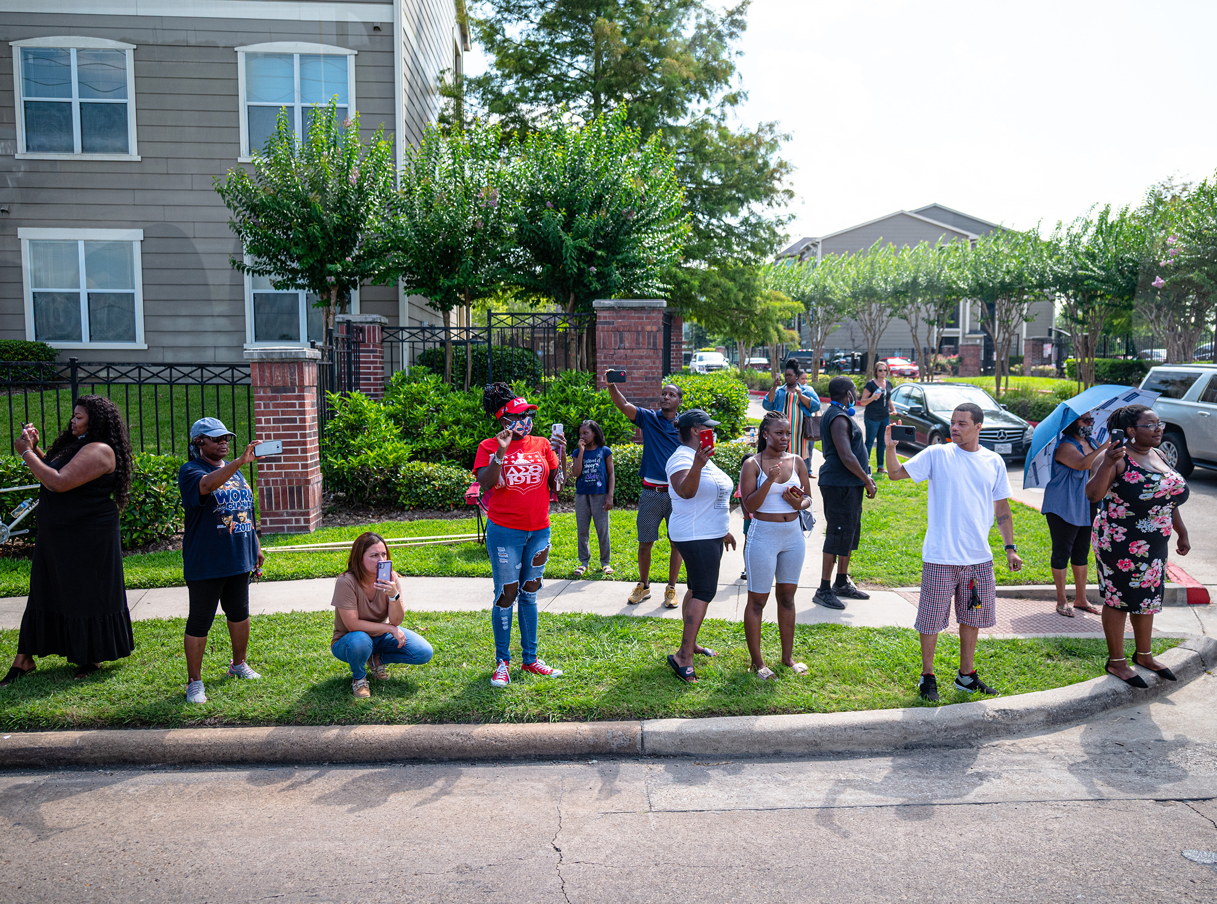 Onlookers document the passing of George Floyd's funeral procession on June 9.