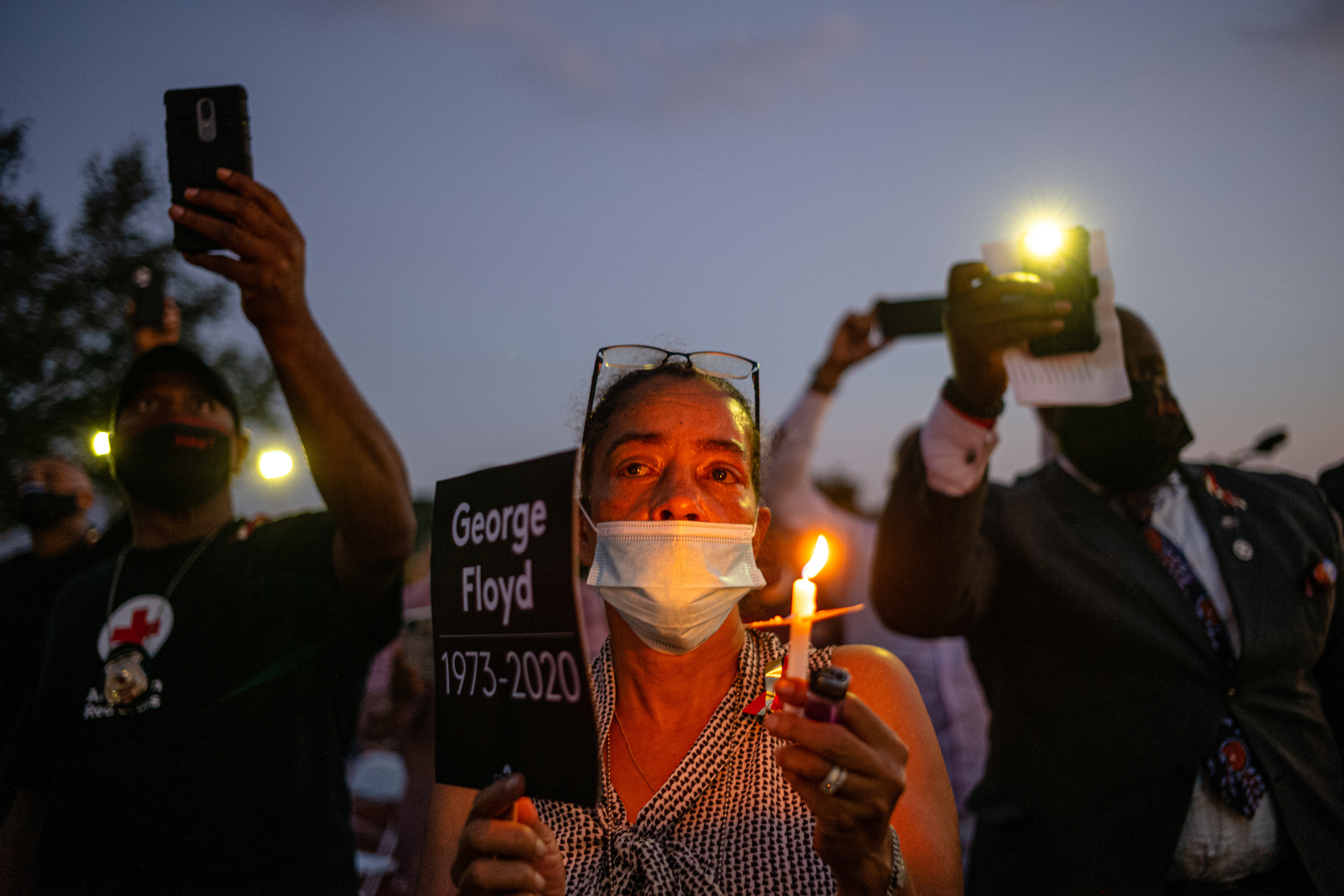 Attendees at a candlelight vigil honoring George Floyd at Jack Yates High School in Houston on June 8.