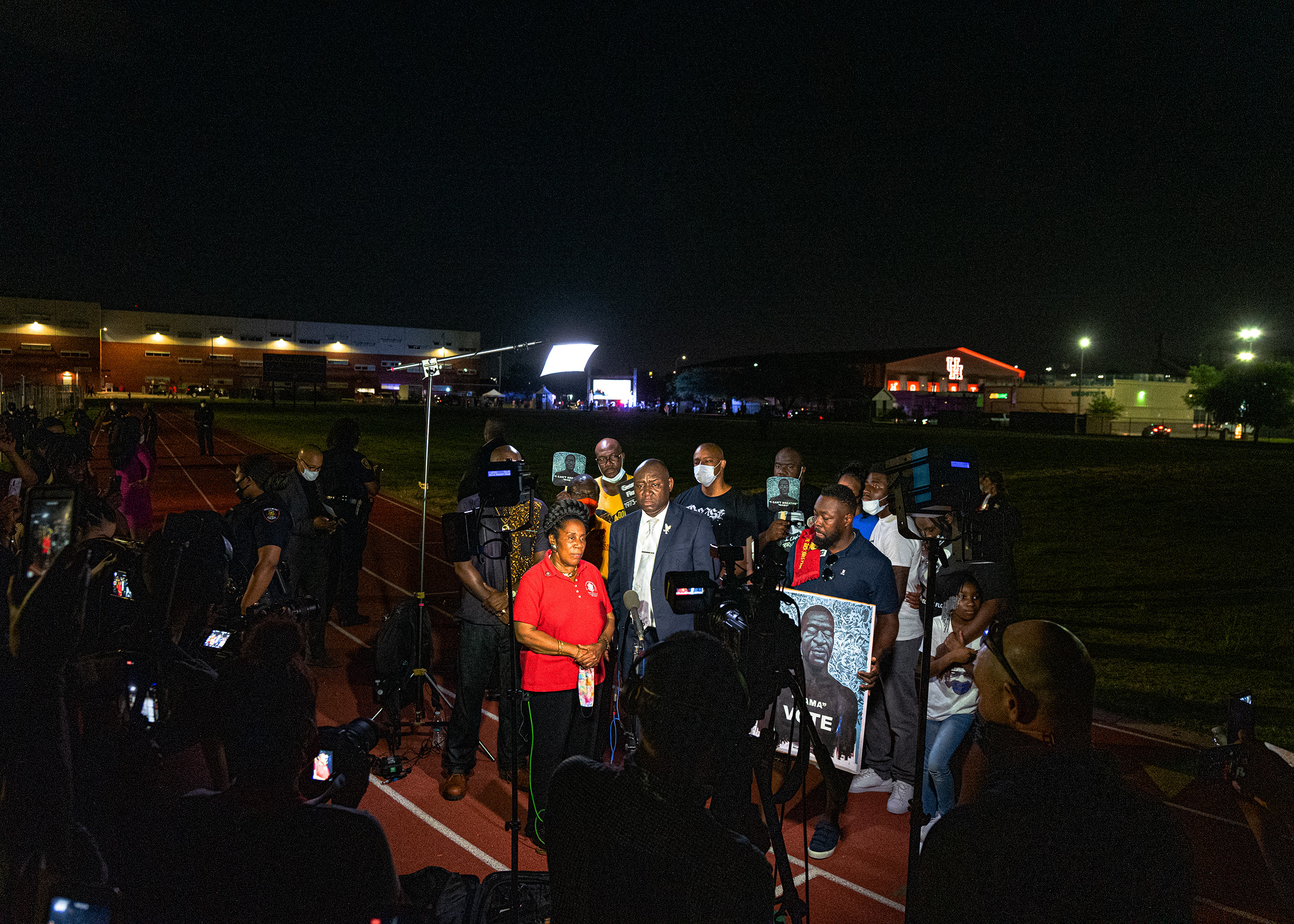 Rep. Sheila Jackson Lee, left, D-Texas, joins the Floyd family, family attorney Ben Crump to speak to reporter after a candlelight vigil honoring George Floyd at Jack Yates High School in Houston on June 8.