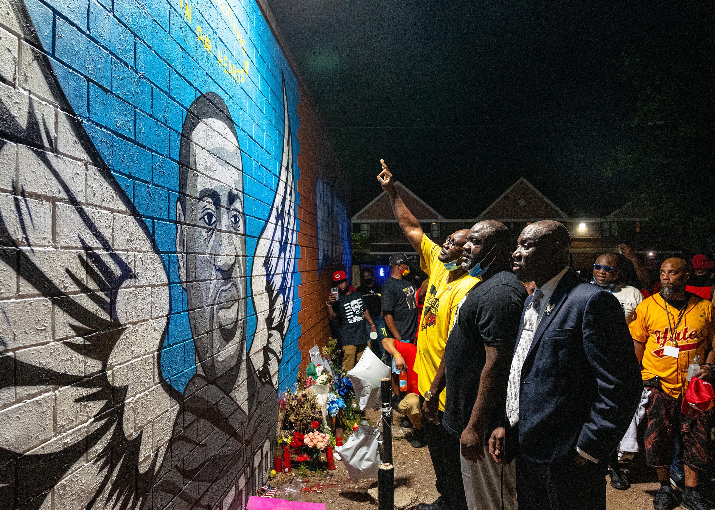 Brothers Rodney and Philonise Floyd visit a memorial and mural that honors their brother George with lawyer, Ben Crump in Houston's Third Ward where Mr. Floyd grew up, on June 8.