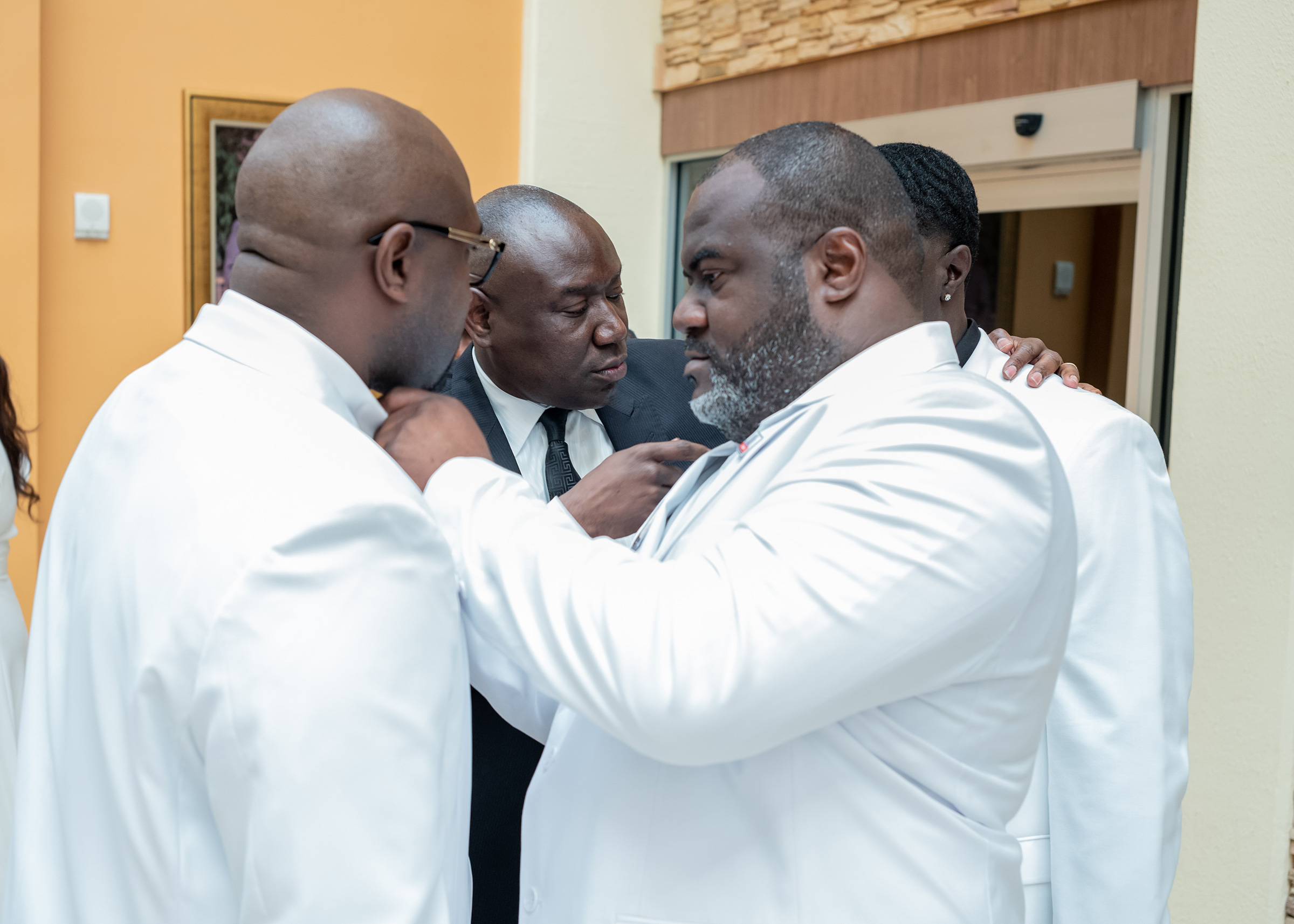 George Floyd's brothers Rodney (right) and Philonise (left) prepare for the funeral with lawyer Ben Crump (center) on June 9.