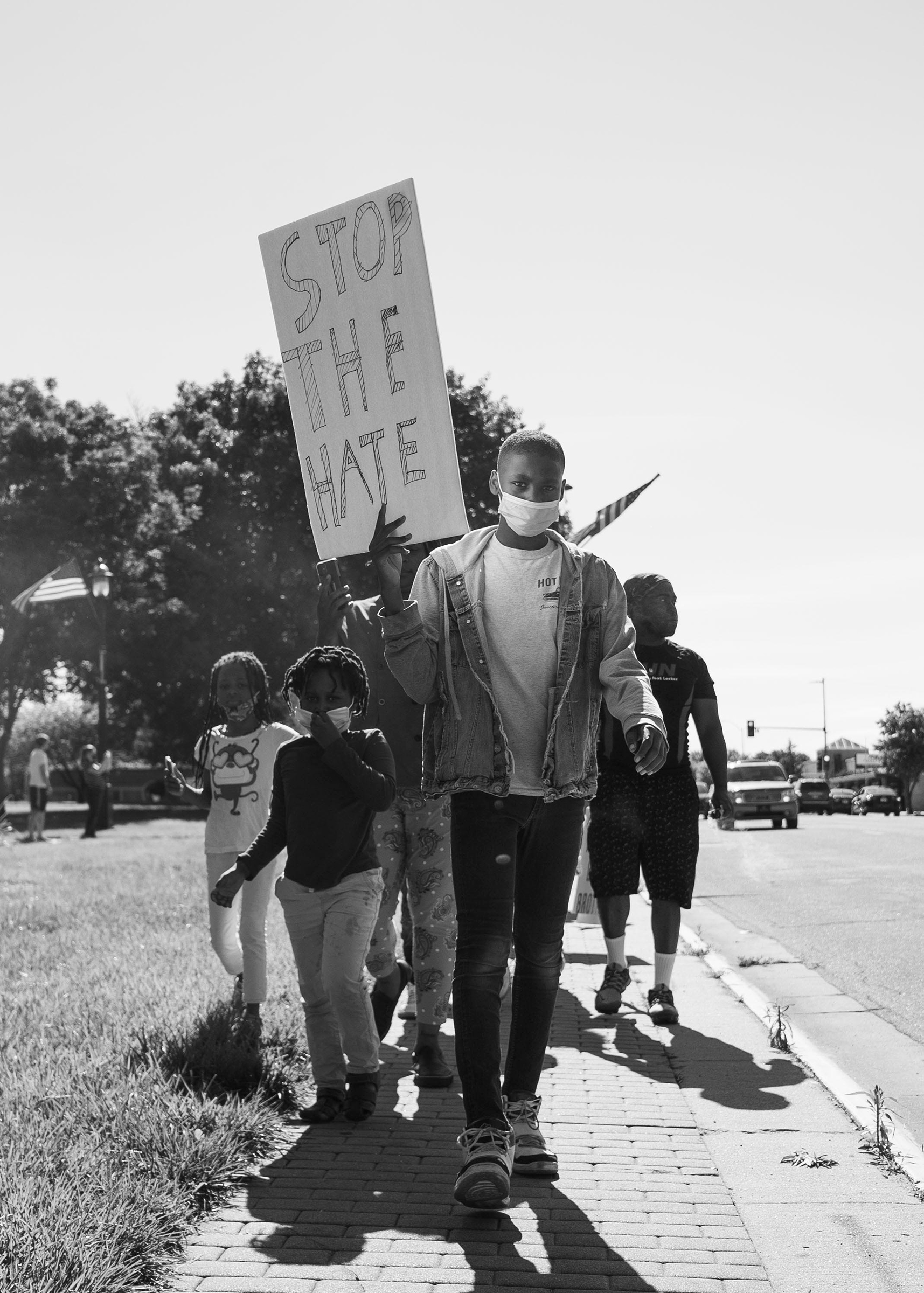 Jason Allende, 13, walks before his mother and siblings, protesting the death of George Floyd in Junction City, Kans., May 29, 2020.