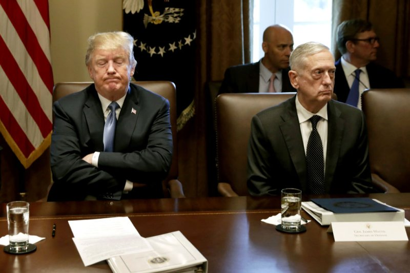 U.S. President Donald Trump, left, pauses while speaking as James Mattis, then U.S. Secretary of Defense, listens during a Cabinet meeting at the White House in Washington, D.C., U.S., on June 21, 2018.