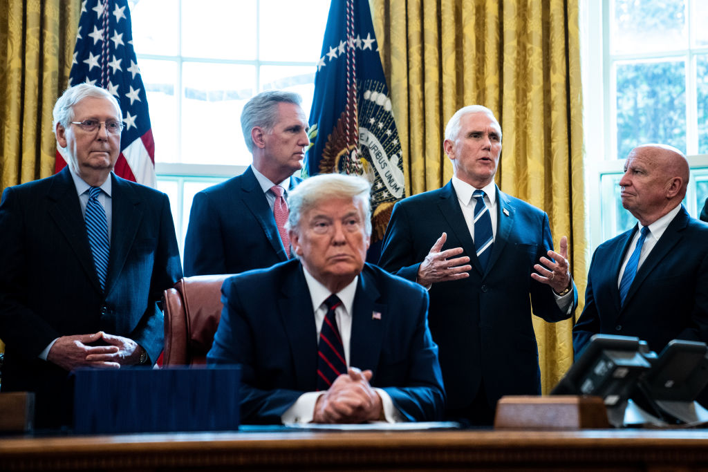 President Donald Trump listens during a bill signing ceremony for the CARES Act on March 27, 2020