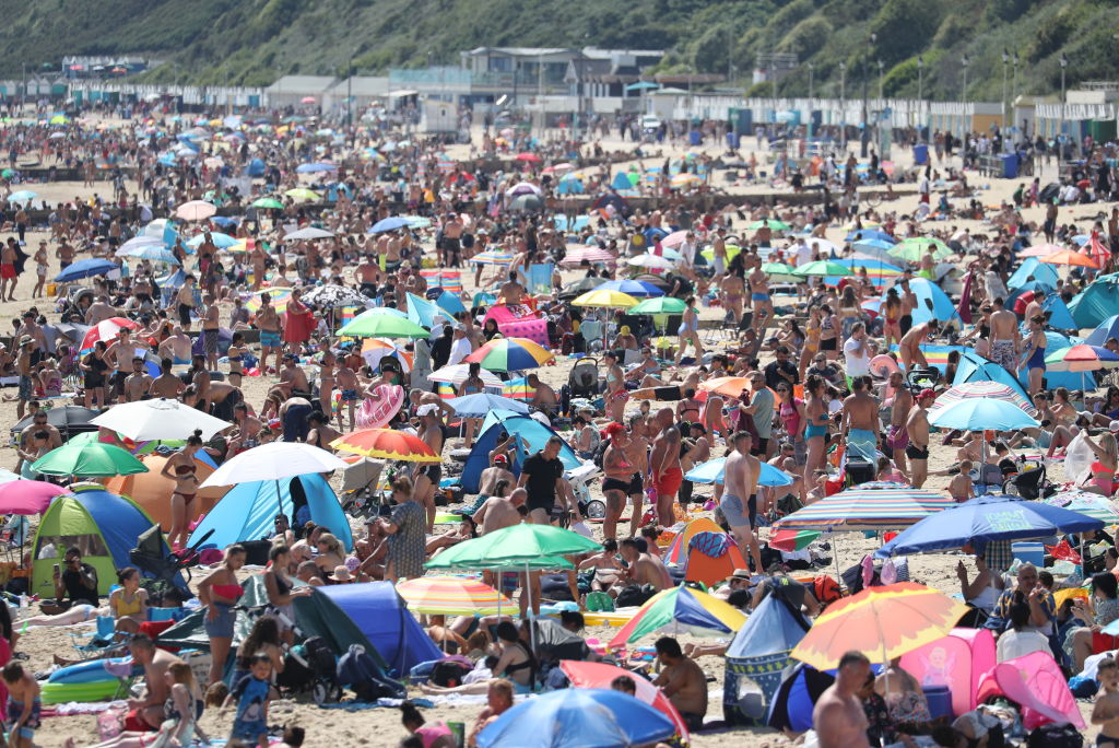 People on the beach in Bournemouth, Dorset, as the public are being reminded to practice social distancing following the relaxation of the coronavirus lockdown restrictions in England.