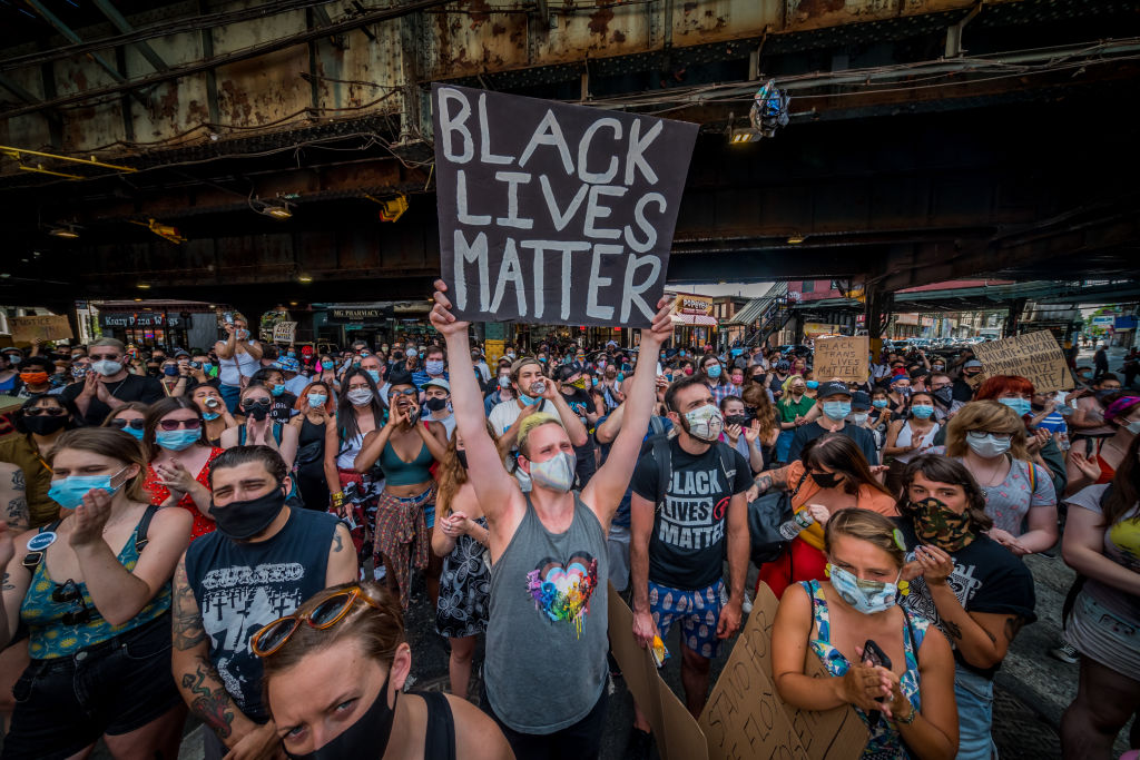 A participant holding a Black Lives Matter sign at a protest in Brooklyn, N.Y., on June 6, 2020.