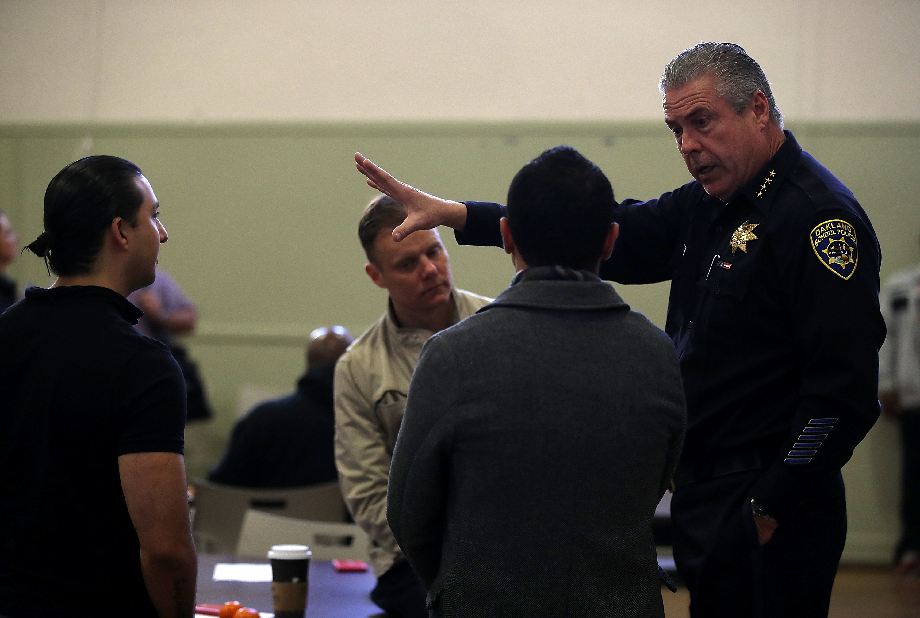 Oakland Schools Police chief Jeff Godown (R) speaks to school staff during an active shooter training session on Feb. 16, 2018 in Oakland, Calif. Godown supported the school district's decision to disband the police force, even though it could end his job.