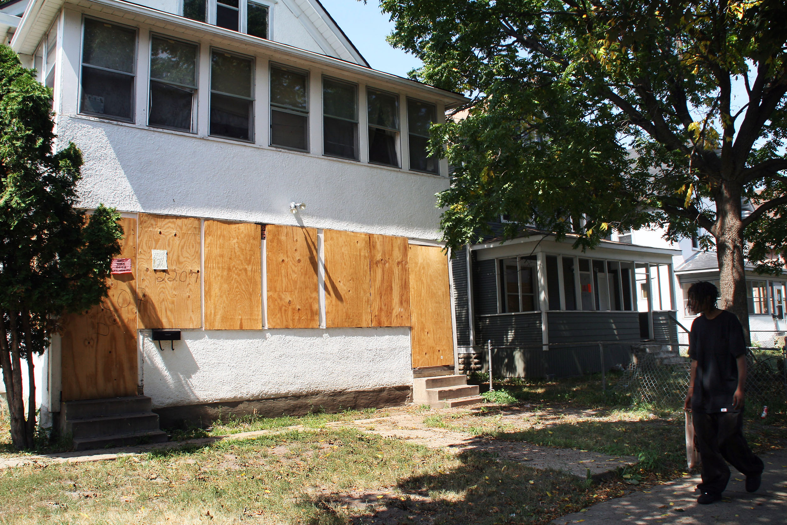 A home is boarded up Aug 10, 2007, in the North Minneapolis, Minnesota, neighborhood, which saw some of the nation's highest foreclosure rates from 2004-2008.