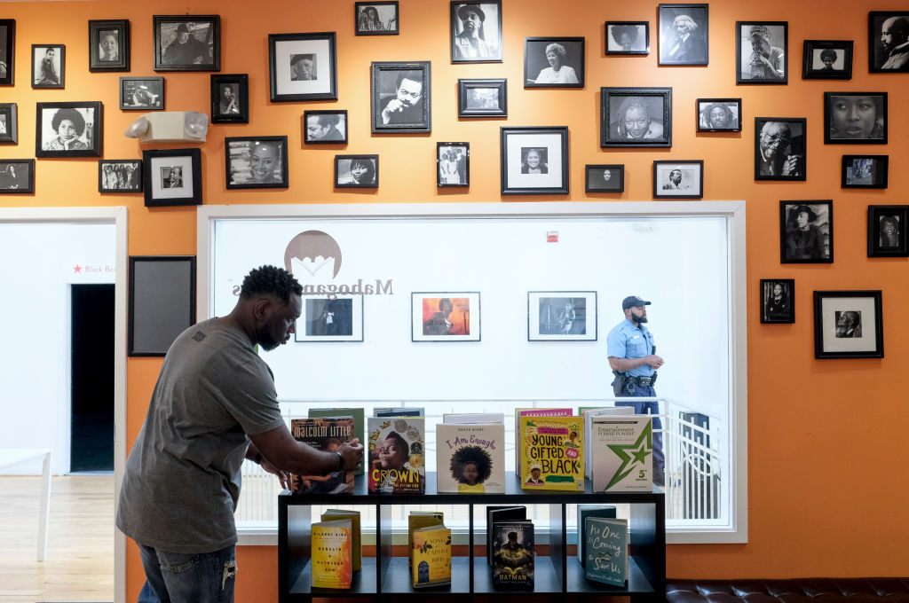 Derrick Young organizes books at Mahogany Books in Washington, DC on April 27, 2018.