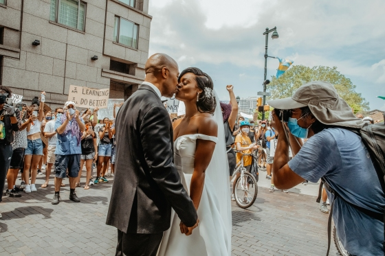 Dr. Kerry Anne Perkins and Michael Gordon join a Black Lives Matter protest taking place alongside their wedding ceremony at The Logan hotel in Philadelphia on June 6, 2020.