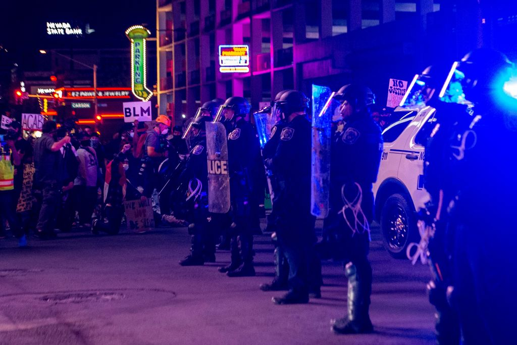 Police officers stand guard, on June 1, 2020, in downtown Las Vegas, during a 'Black lives matter' rally in response to the recent death of George Floyd, an unarmed black man who died while in police custody.