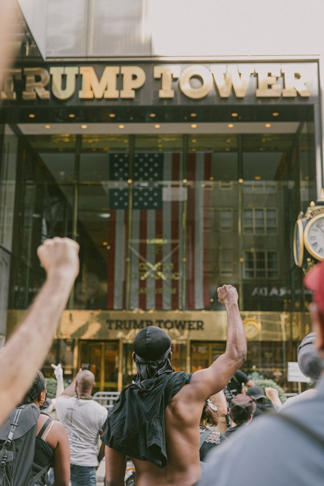Protestors marching down 5th Avenue stop and stand before Trump Tower in New York City, May 30, 2020.