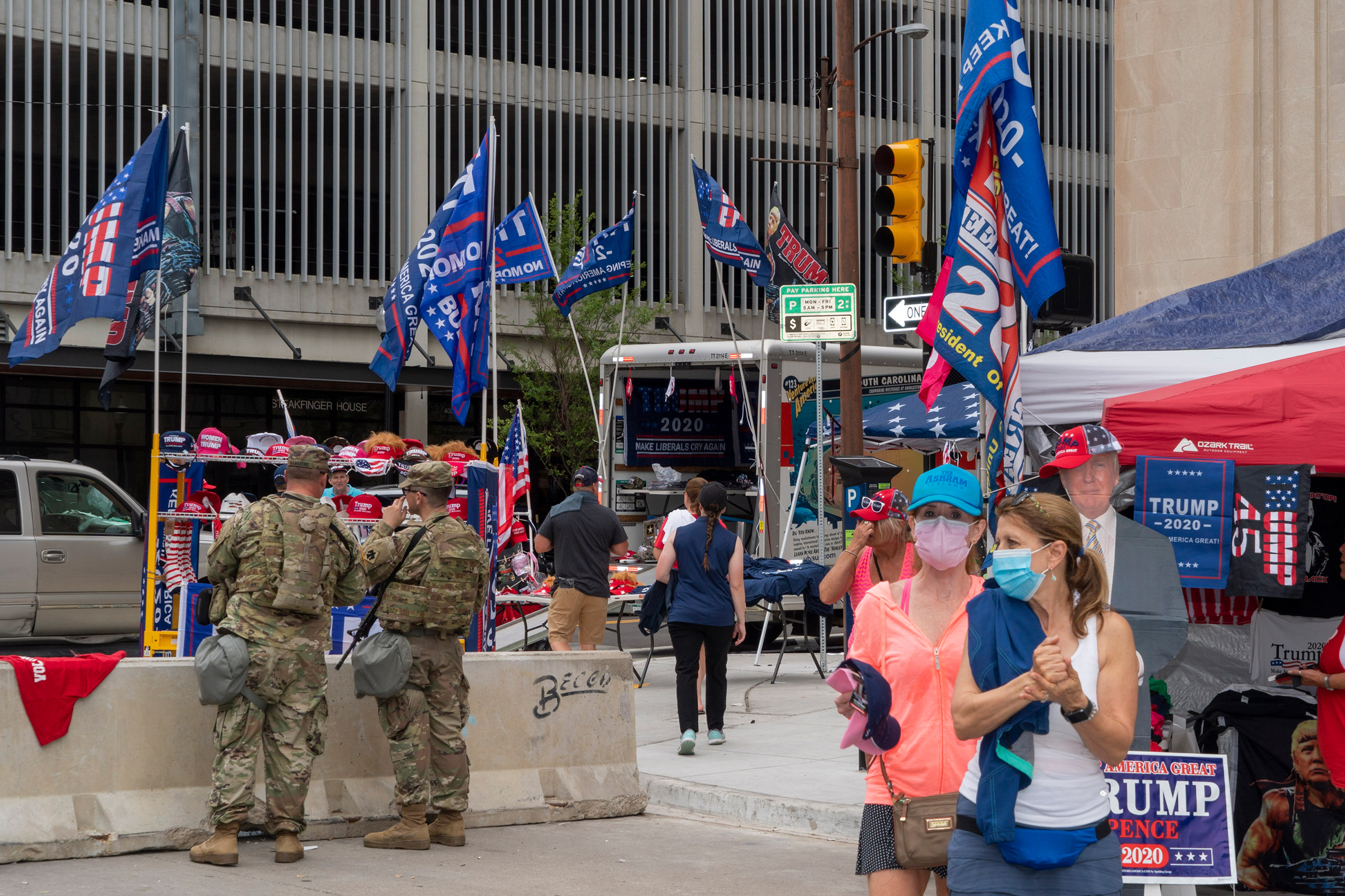 National Guard and vendors selling Trump memorabilia near an entrance to the Trump rally at the BOK Center in Tulsa, Okla., on June 20, 2020.