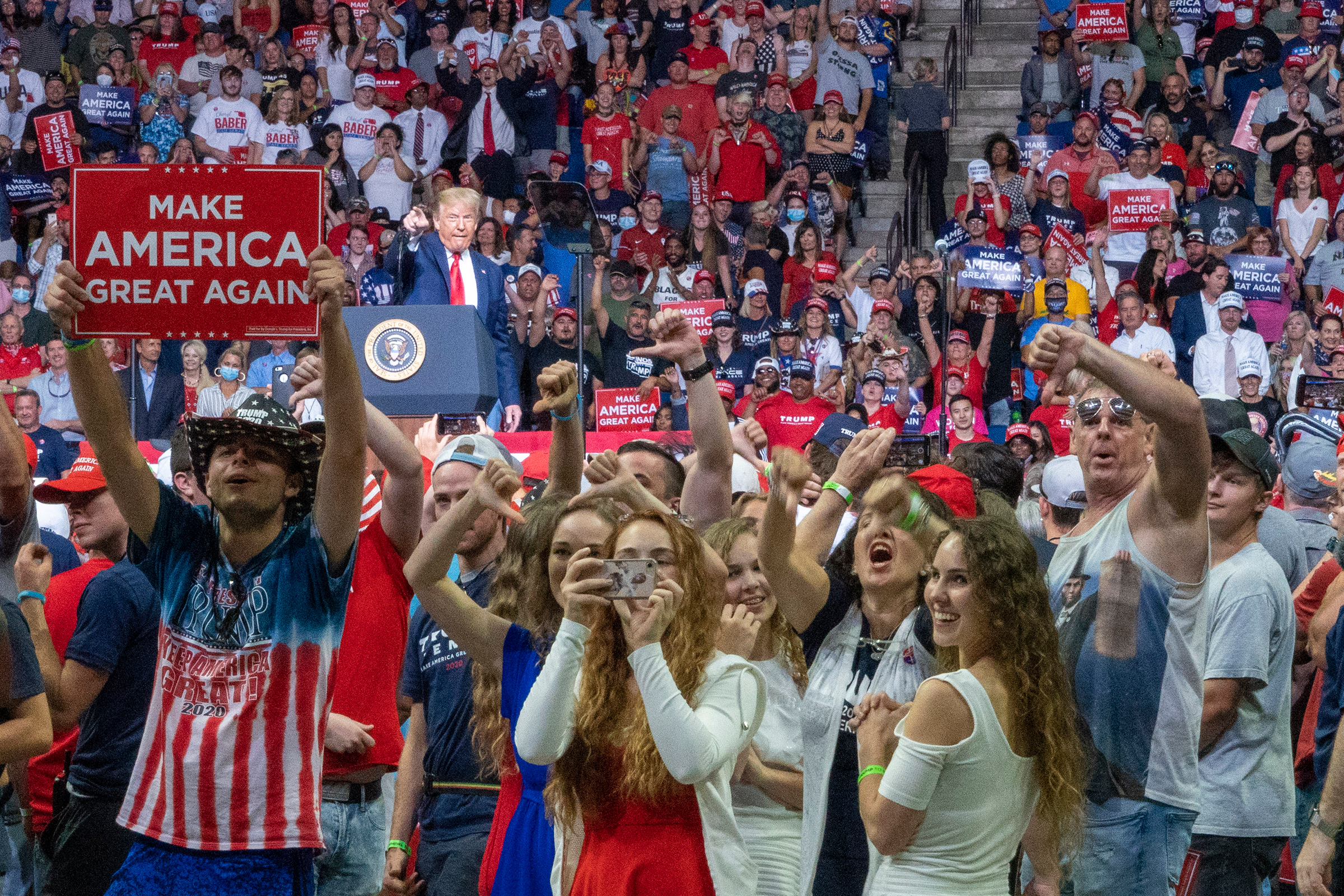 President Donald Trump stokes the crowd into booing the media during a campaign rally at the BOK Center in Tulsa, Okla., on June 20, 2020.