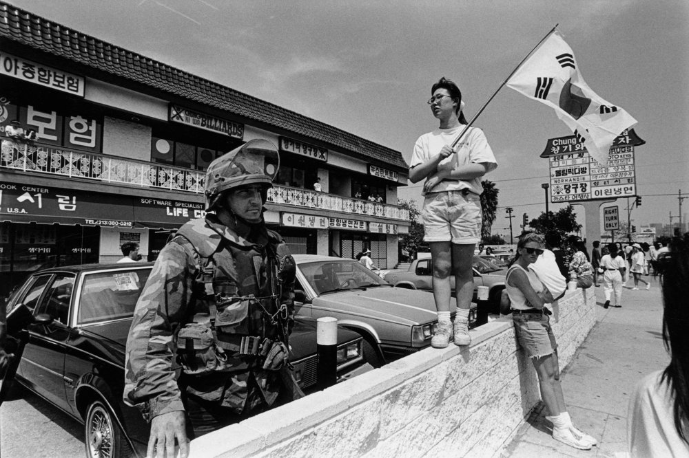 The National Guard at the Korean Pride Parade in Los Angeles on April 29, 1992 following the riots that swept the city after three of four police officers accused of the 1991 beating of Rodney King were cleared of all charges.