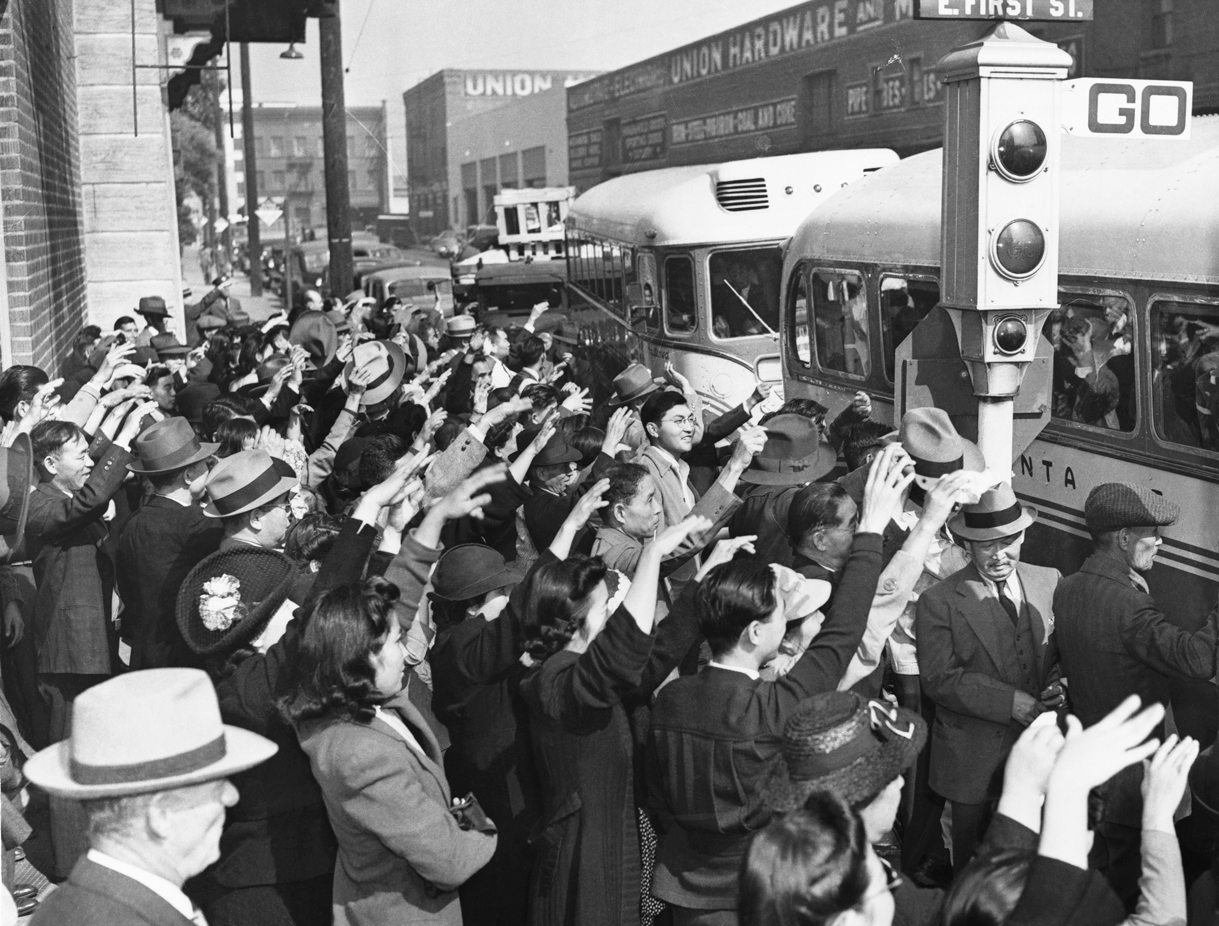 Japanese-American residents of Los Angeles wave a farewell to relatives and friends who are being deported to Japan in October 1941.