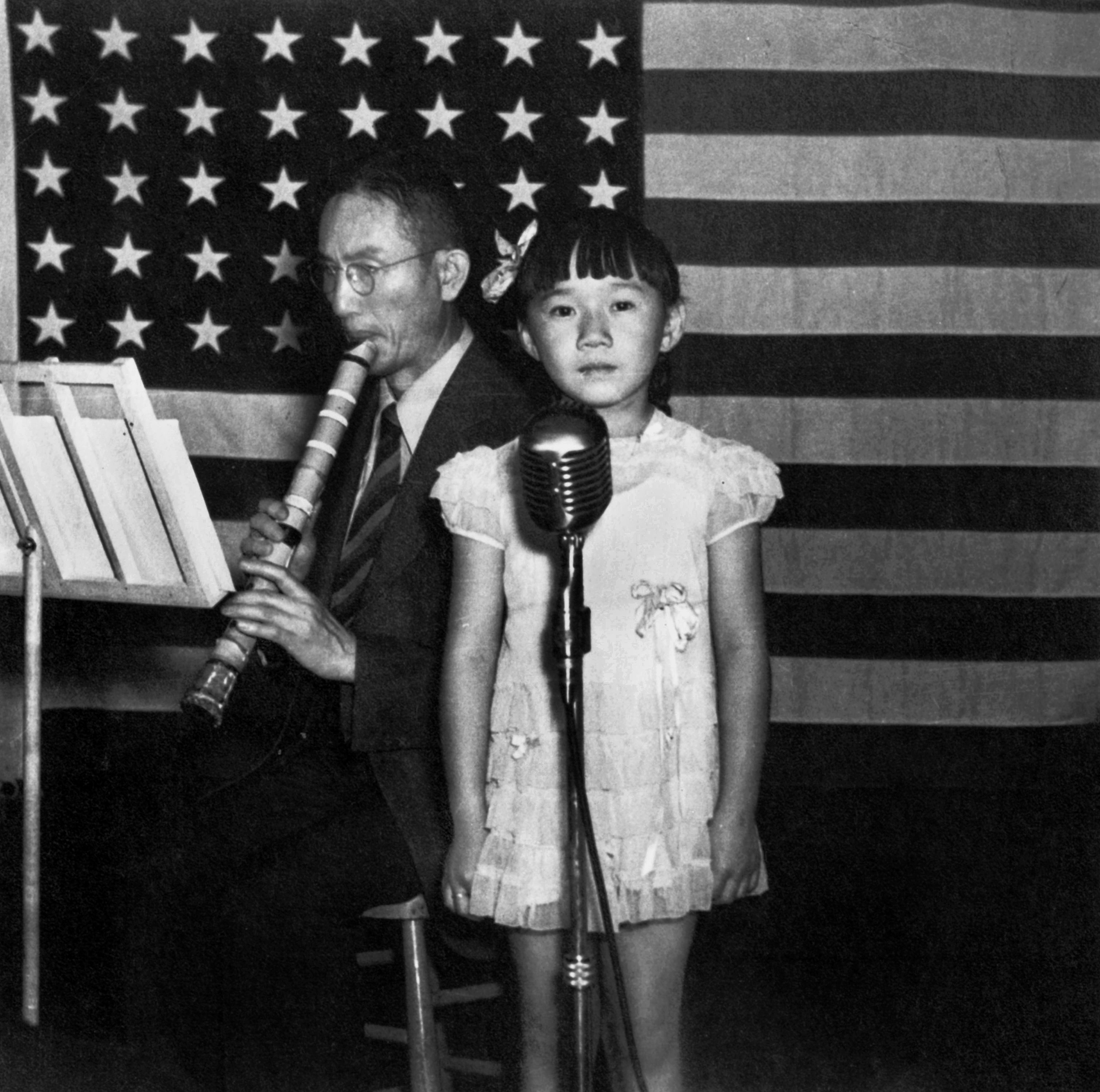 A musician and a girl in Topaz Internment Camp in Utah, July 1945