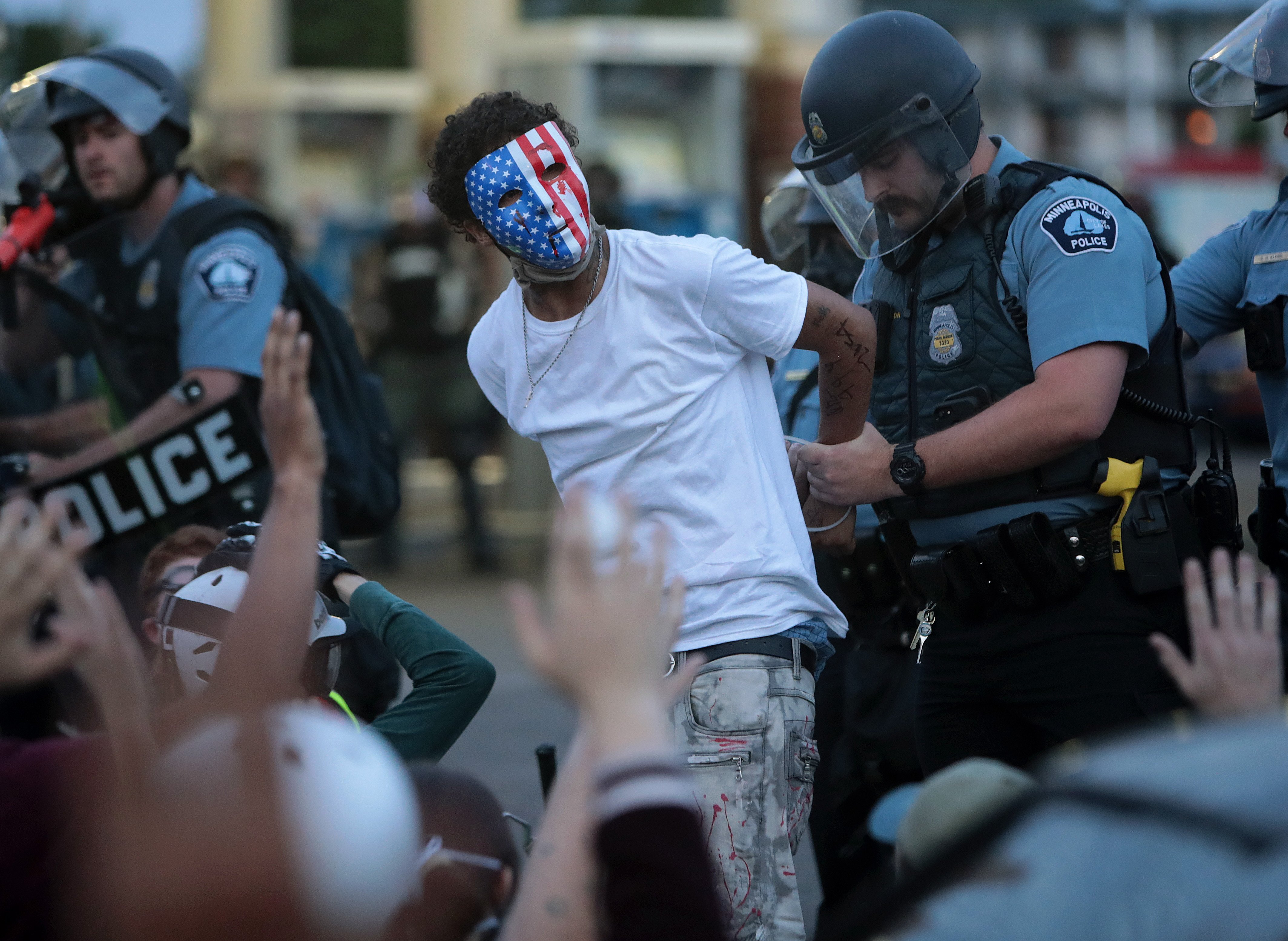 A demonstrator is arressted during a protest against police brutality and the death of George Floyd, on May 31, 2020 in Minneapolis, Minnesota.