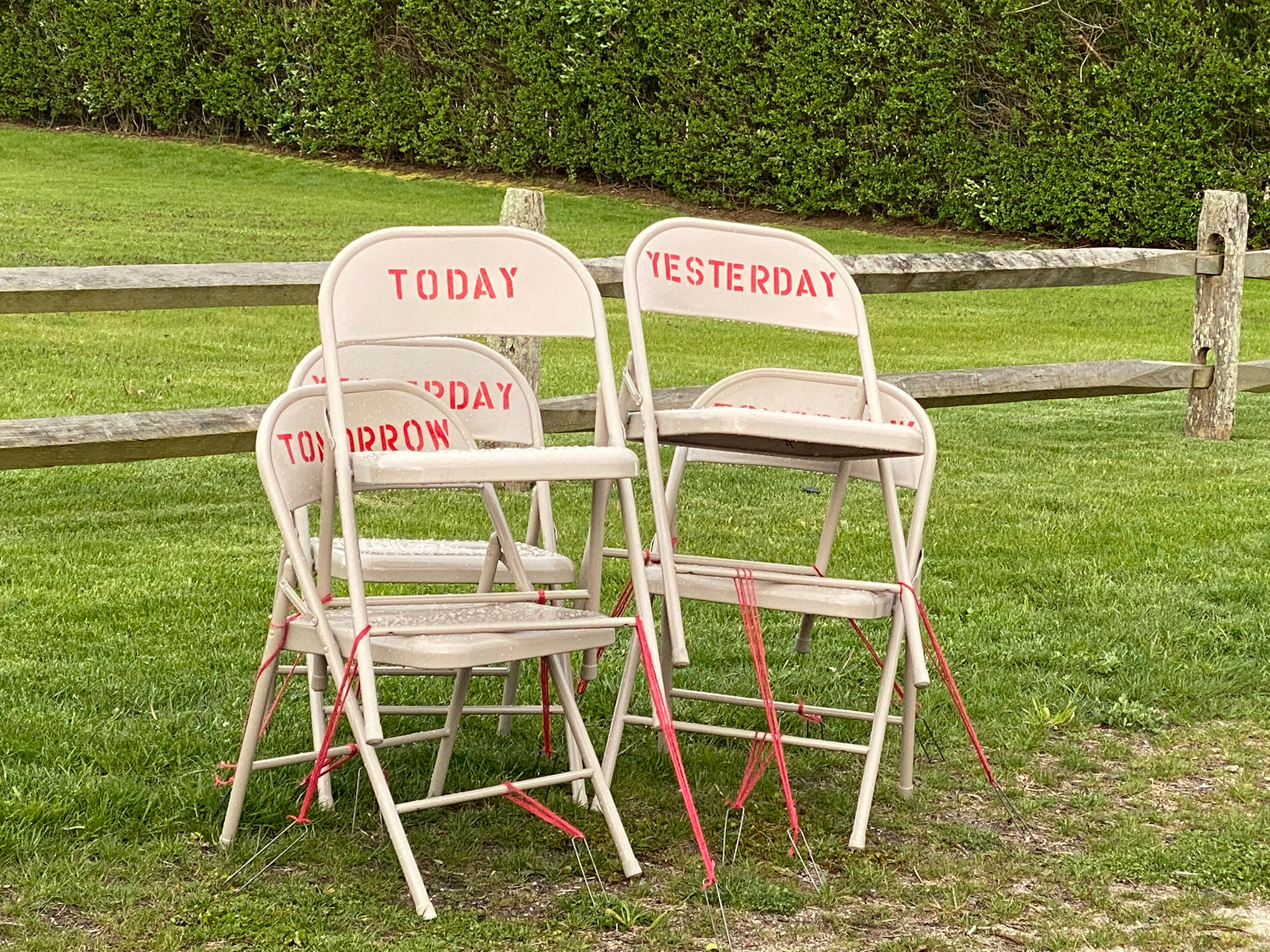 "In a ""Drive-by-Art"" show in New York, Toni Ross and Sara Salaway exhibited When, a social-­isolation ""calendar"" of jumbled chairs with date-related words"