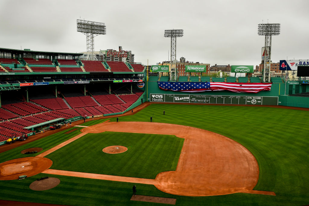 The American flag is dropped over the Green Monster on Memorial Day as the Major League Baseball season is postponed due to the coronavirus pandemic on May 25, 2020 at Fenway Park in Boston, Massachusetts.