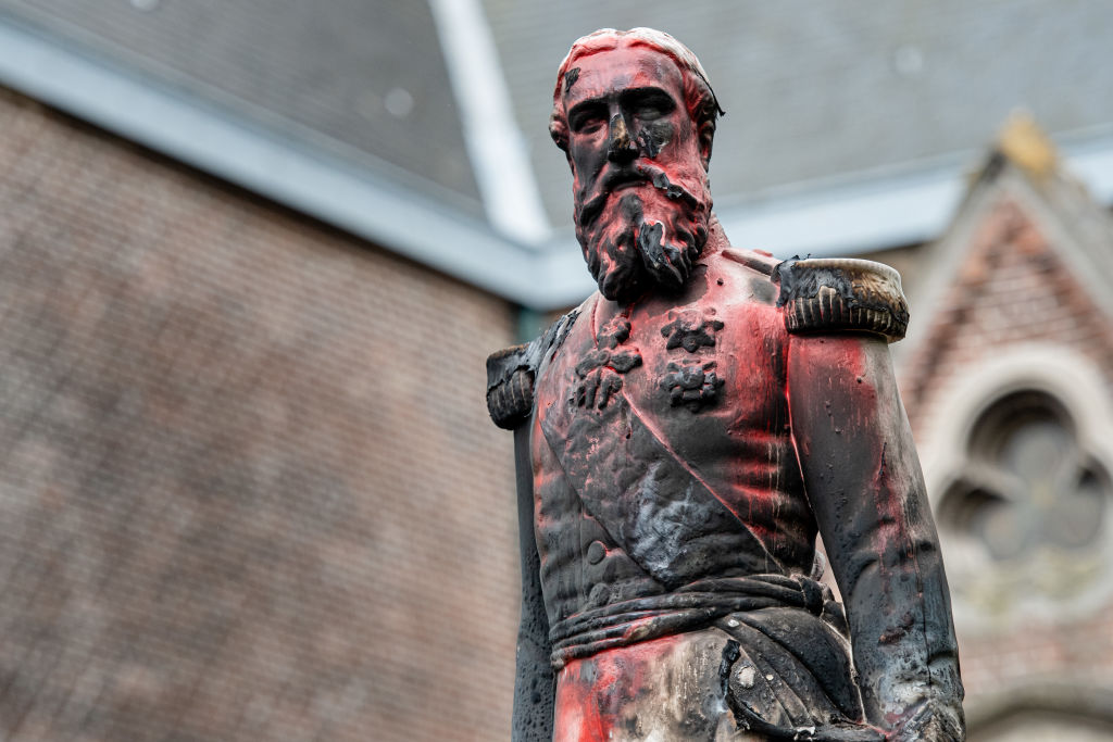 A statue of King Leopold II of Belgium is pictured on June 4, 2020 in Antwerp after being set on fire the night before as a petition was launched on June 1 to remove all statues in honor of this colonial-era King from the City of Brussels amidst worldwide anti-racist protests.