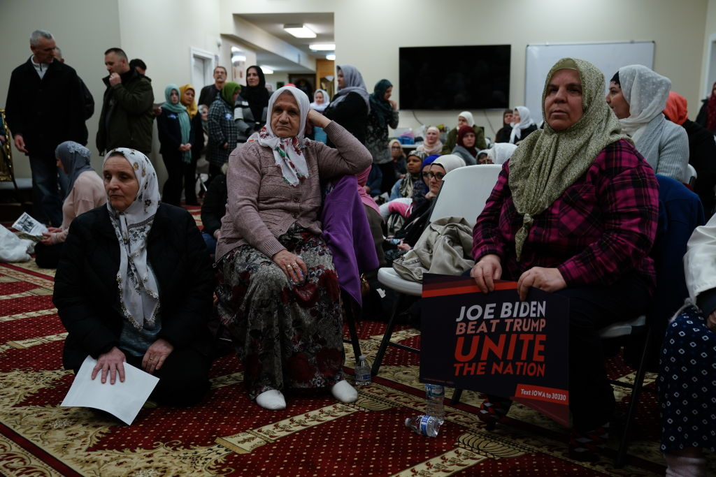 A participant holds a campaign sign for former U.S. Vice President Joe Biden, 2020 Democratic presidential candidate, during the first-in-the-nation Iowa caucus at the Islamic and Education Center Ezan mosque in Des Moines, Iowa, on Feb. 3, 2020.