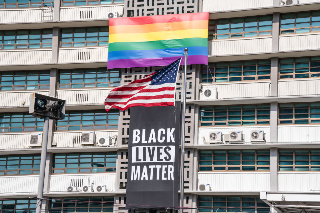 A Black Lives Matter banner, a United States national flag and a rainbow flag are hung on the facade of the US embassy building in Seoul.